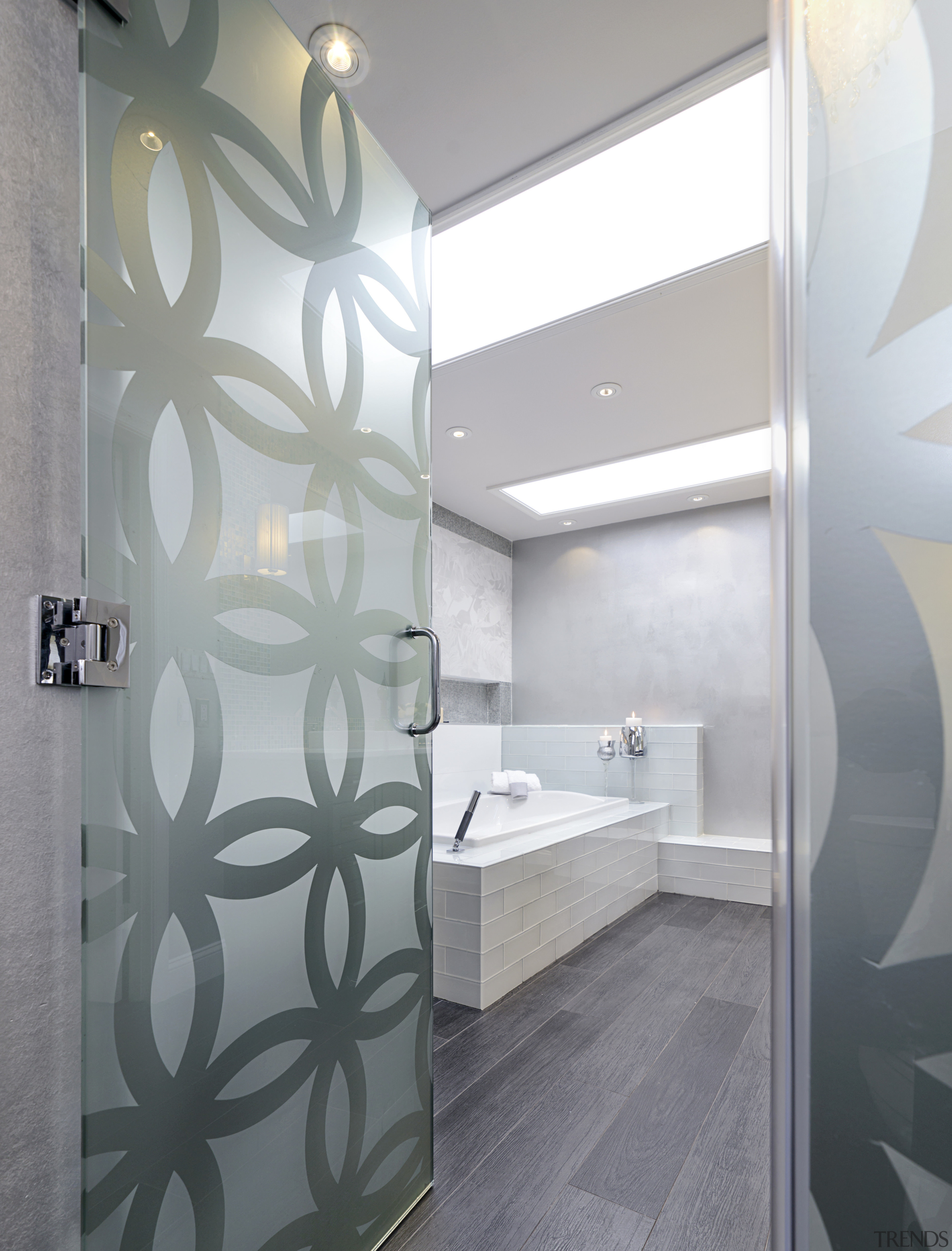 A patterned glass privacy wall screens the shower architecture, bathroom, ceiling, daylighting, floor, interior design, room, wall, gray