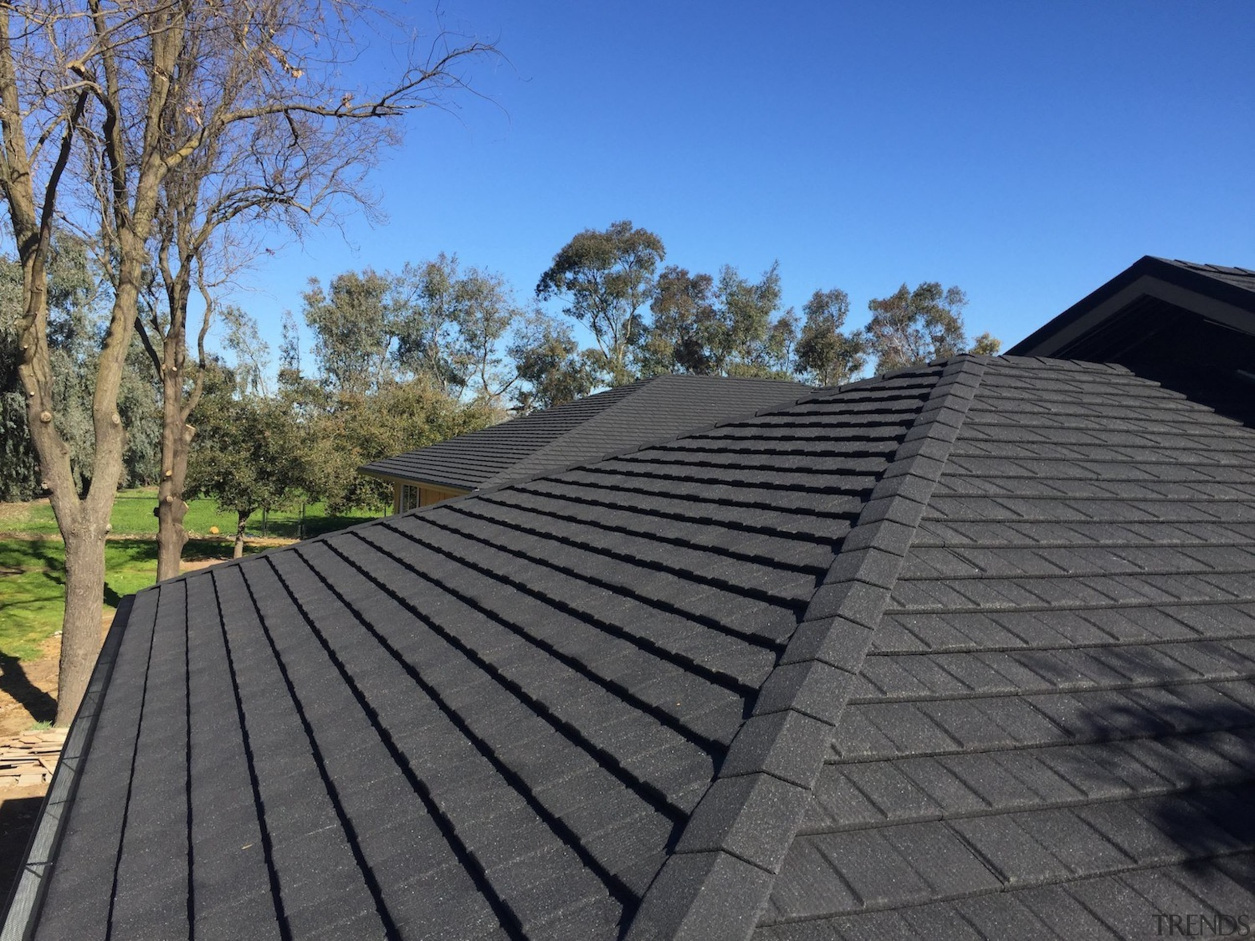 A brand new roof - daylighting   outdoor daylighting, outdoor structure, roof, roofer, sky, gray, black, blue