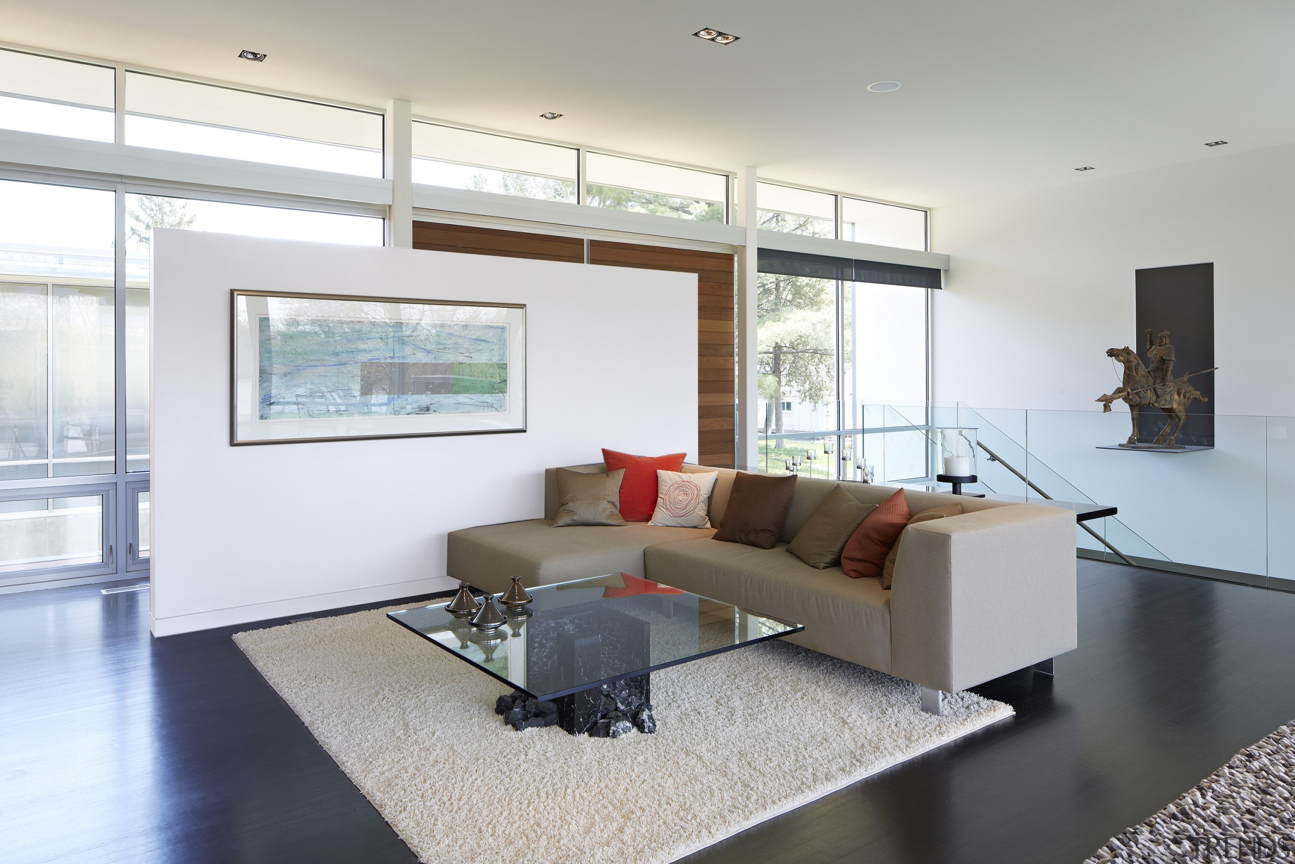 This open-plan living area is separated from the architecture, ceiling, daylighting, floor, flooring, house, interior design, living room, property, real estate, room, window, white, gray