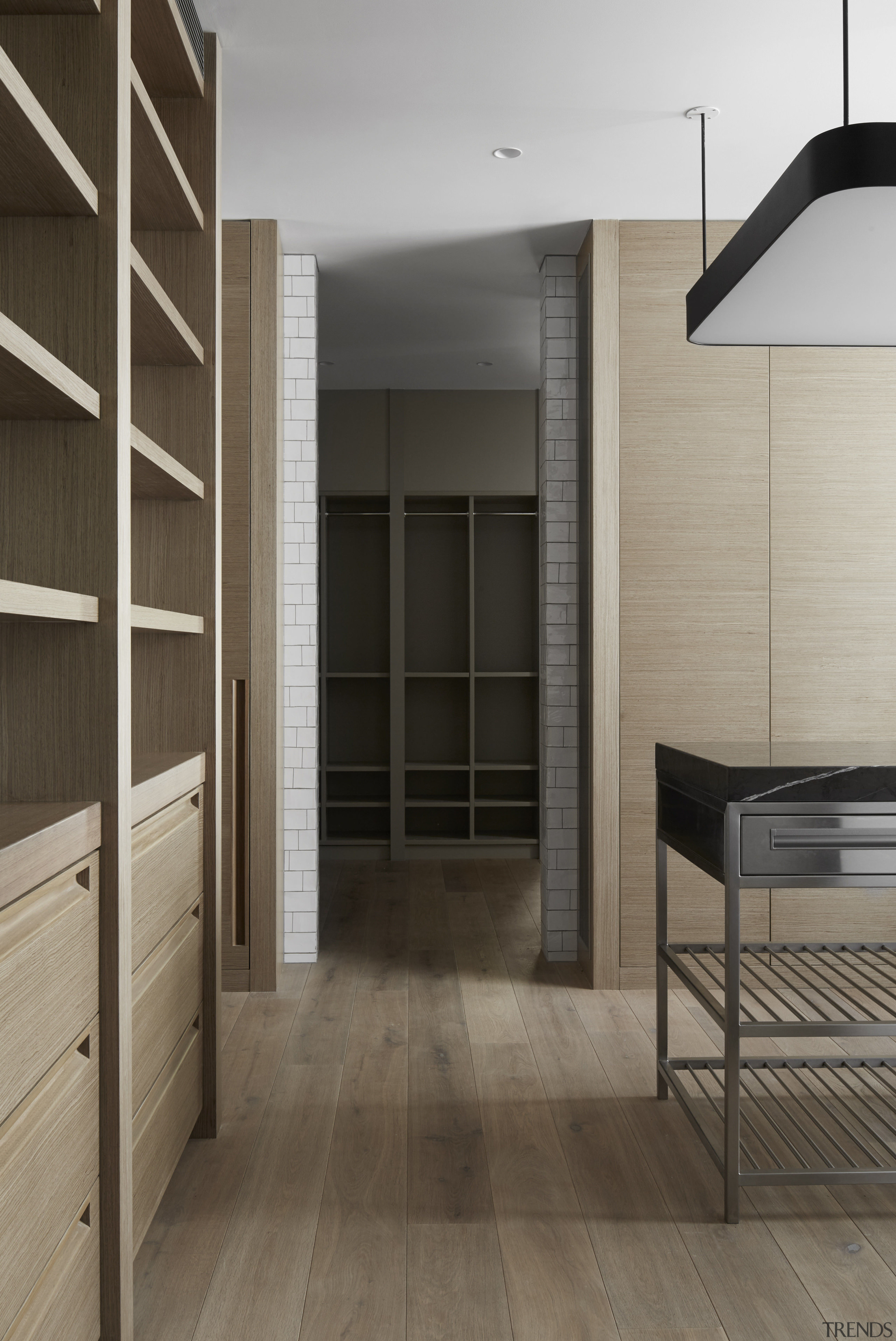 This kitchen pantry, its adjoining kitchen, and ancillary architecture, cabinetry, floor, flooring, interior design, laminate flooring, wood, wood flooring, gray, brown