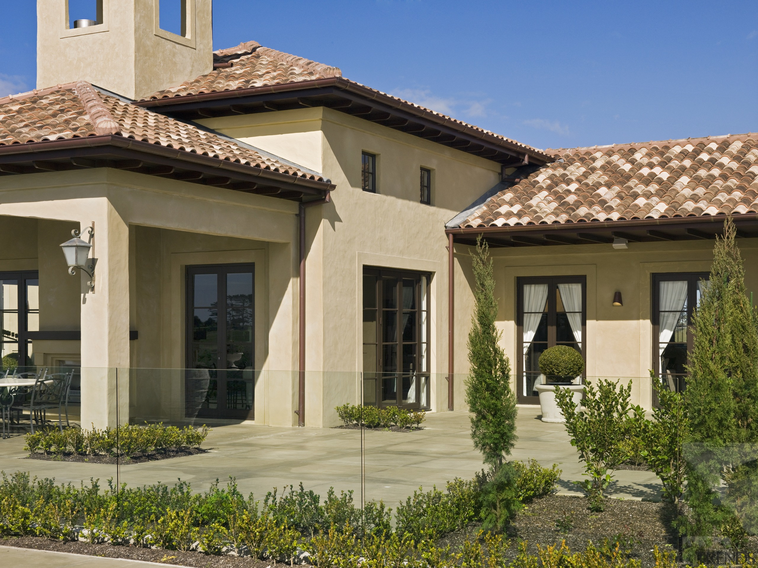 A view of a home designed by Masonry estate, facade, home, house, property, real estate, residential area, roof, villa, window, brown, orange