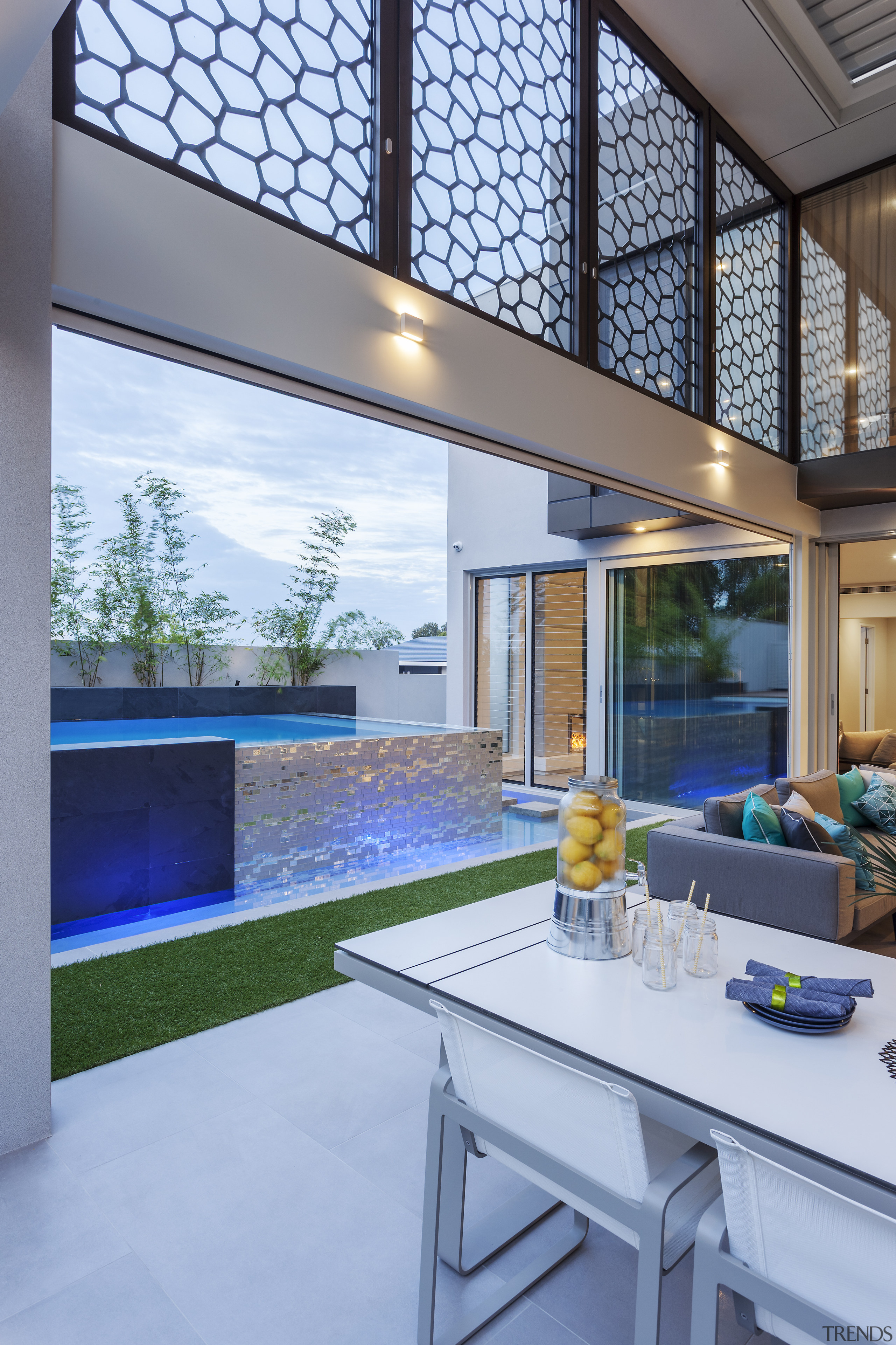 ​​​​​​​The glass-backed honeycomb mesh on this semi-enclosed outdoor architecture, daylighting, house, interior design, real estate, window, teal