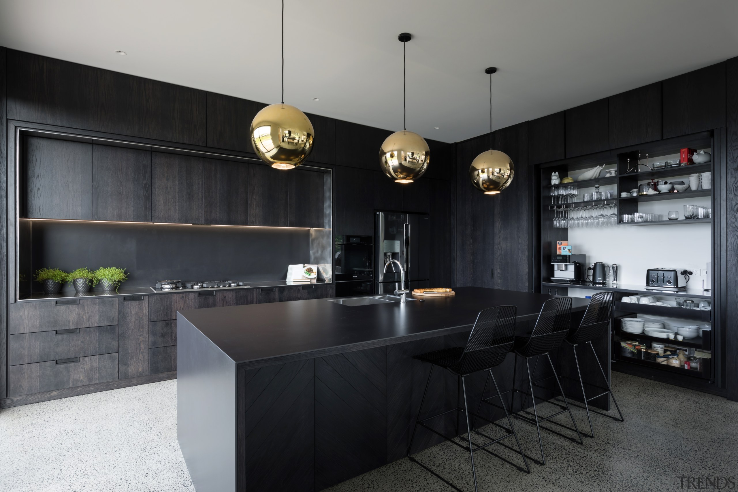 ​​​​​​​Given the 3m-format-sheeting, the Florim Stone on this countertop, interior design, kitchen, black, gray.Florim Stone, Archant