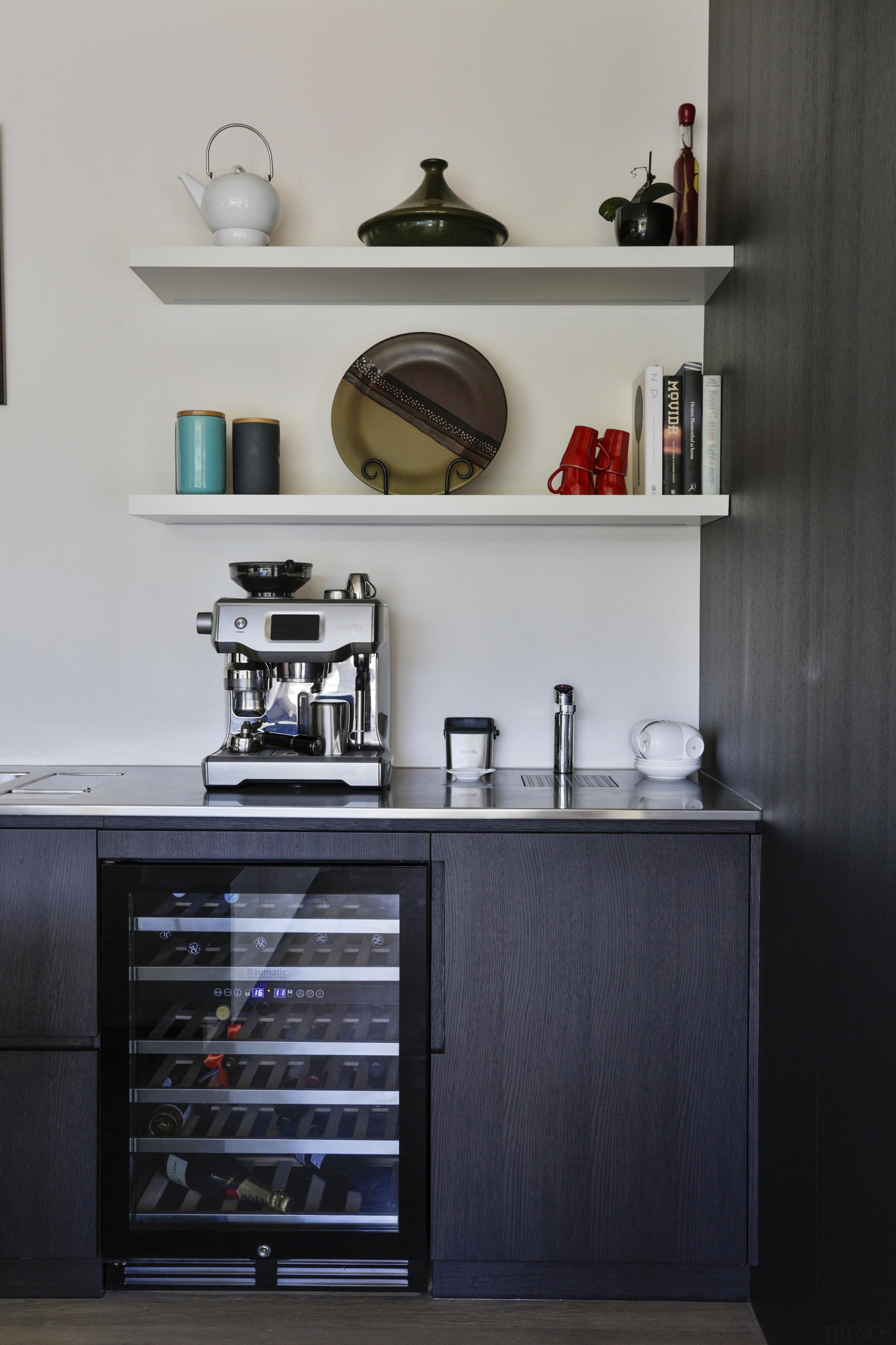 The kitchen boasts a Baumatic wine fridge. -