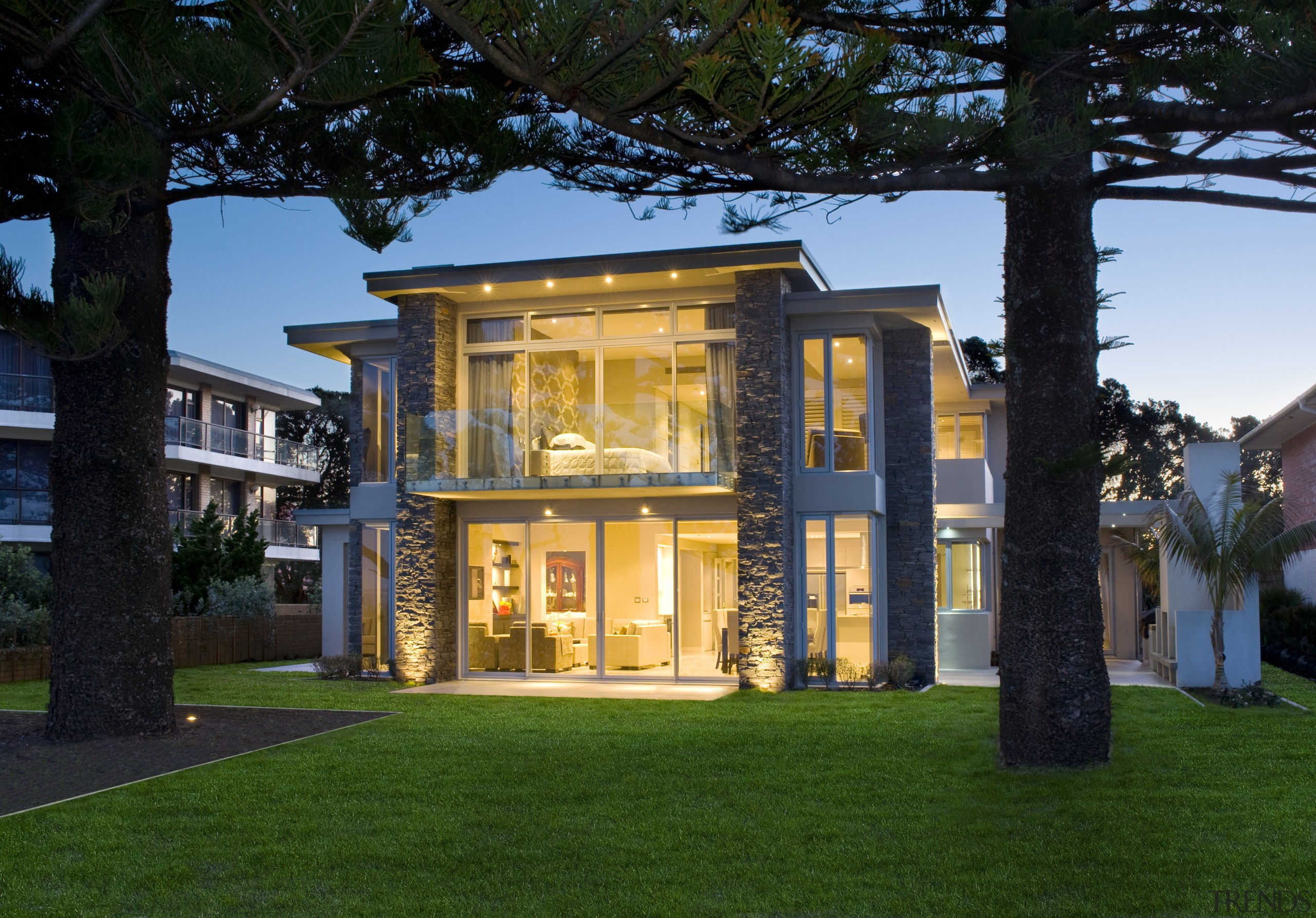 Expansive  glazing and cantilevered balconies maximise the architecture, building, cottage, estate, facade, grass, home, house, lighting, mansion, property, real estate, residential area, villa, window, black, green