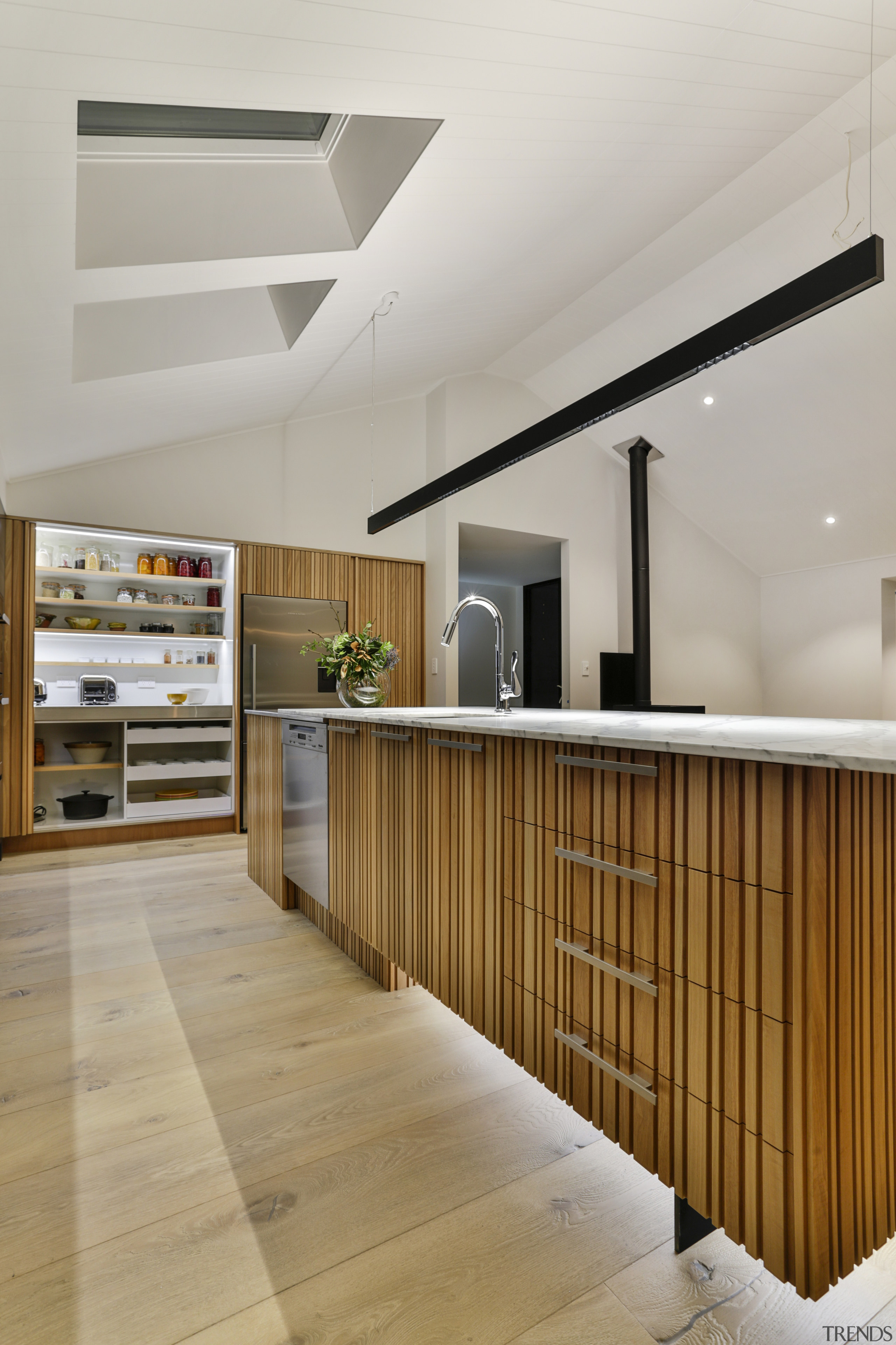 ​​​​​​​In this kitchen by designer Kira Gray, the gray, brown