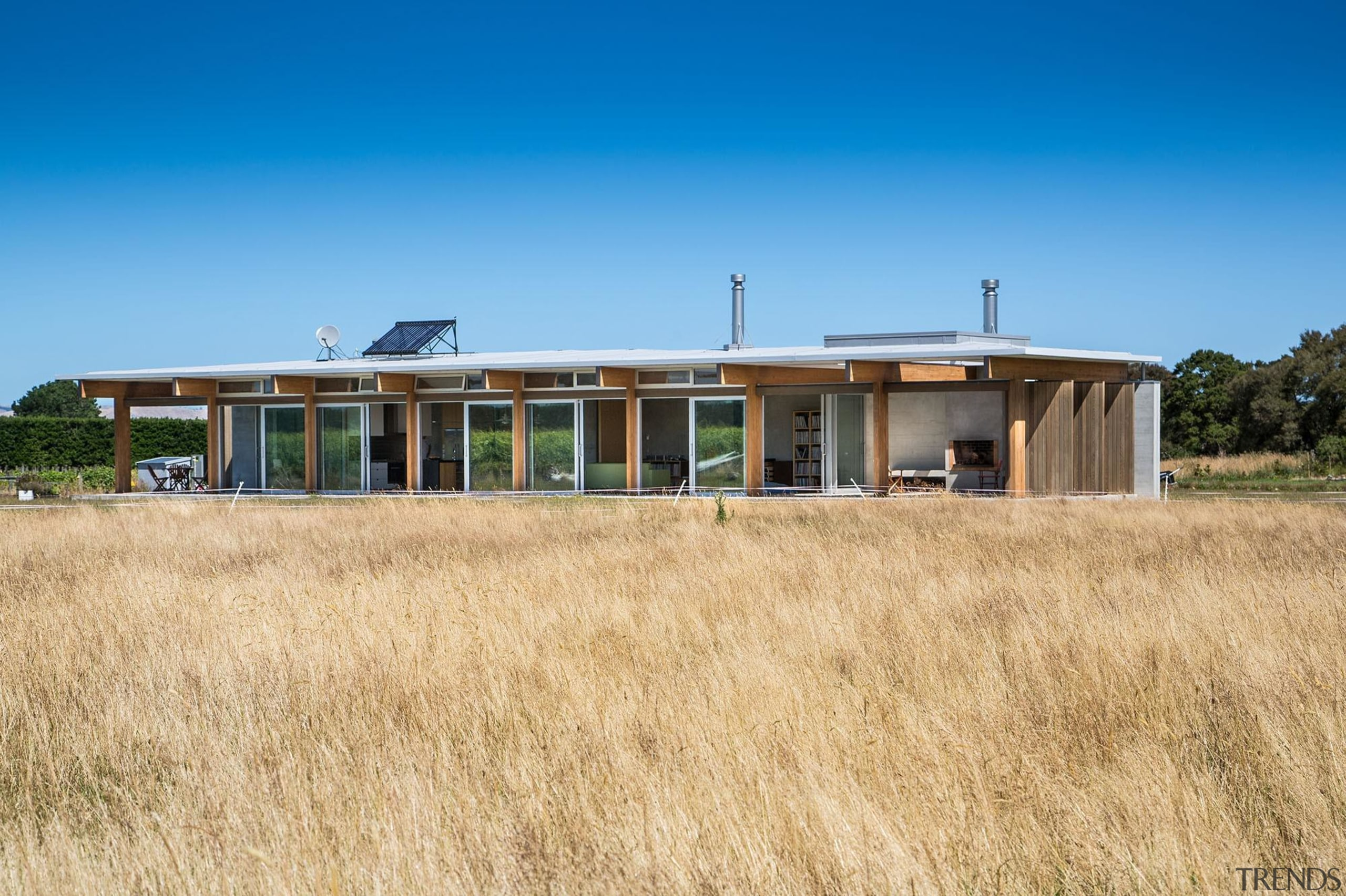Wellington Architecture Awards cottage, farmhouse, field, home, house, land lot, landscape, prairie, property, real estate, sky, orange