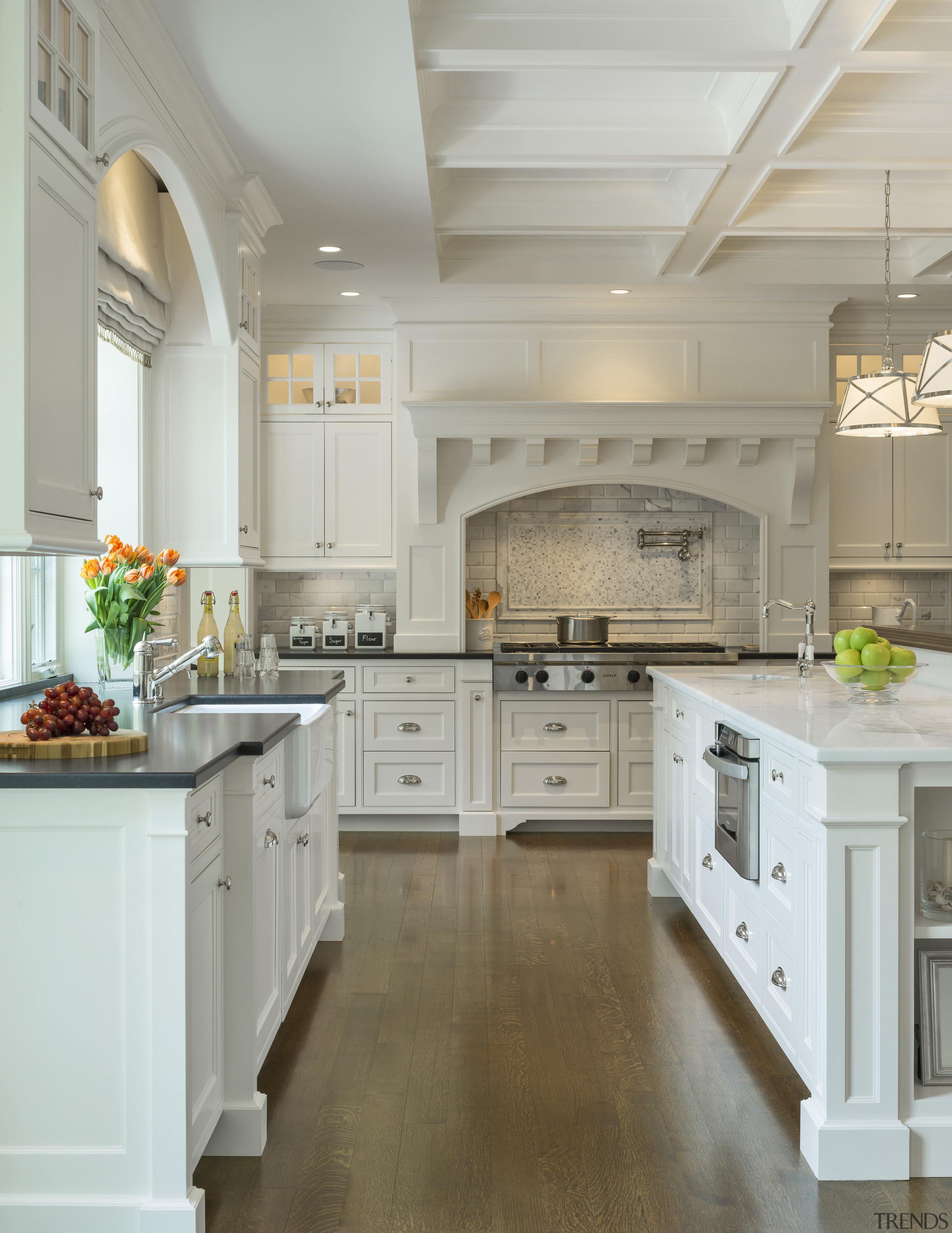 Dark hardwood floors anchor this all-white kitchen in cabinetry, ceiling, countertop, cuisine classique, floor, flooring, hardwood, home, interior design, kitchen, room, wood flooring, gray