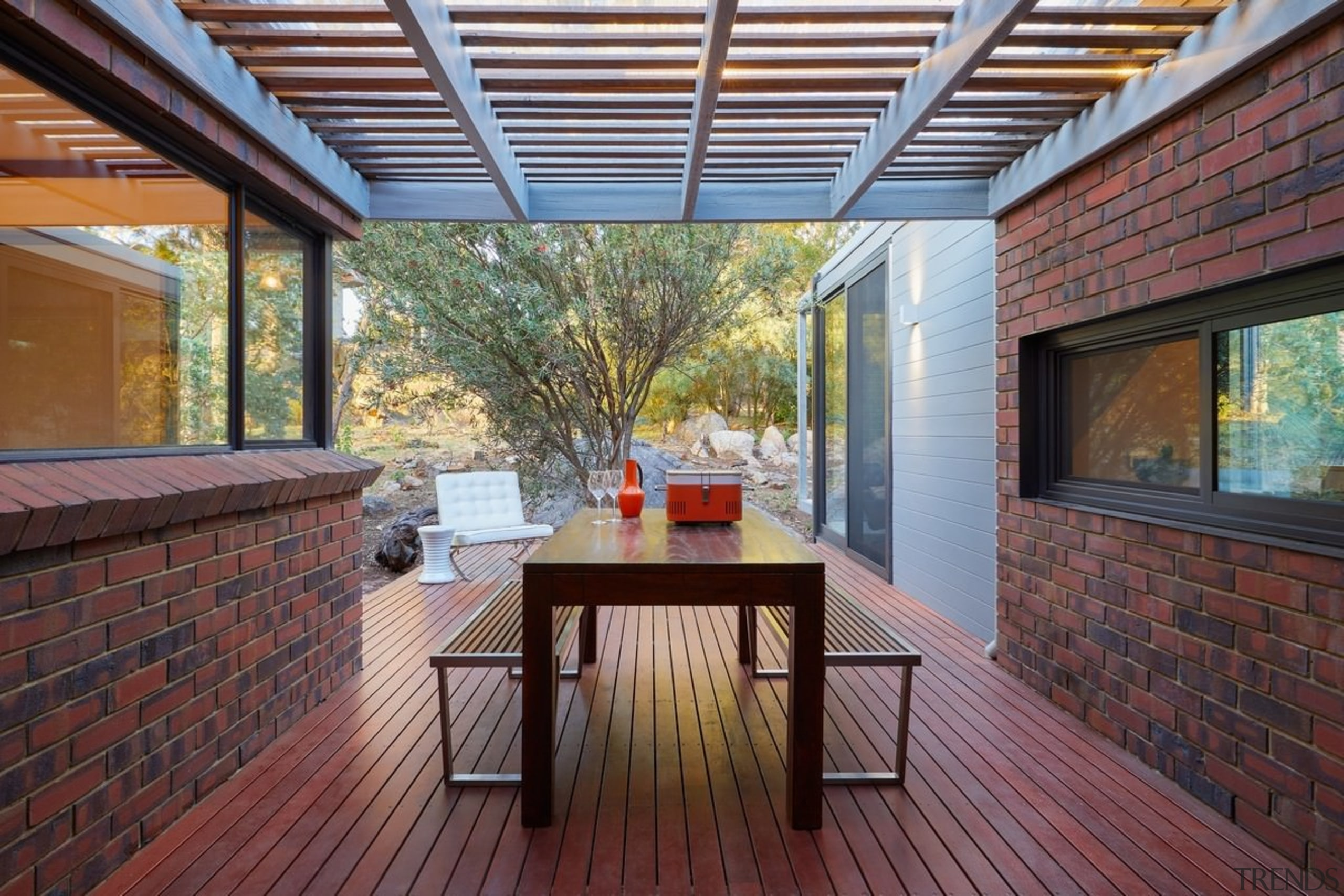 A view of the outdoor room - A architecture, daylighting, deck, hardwood, house, interior design, outdoor structure, patio, real estate, roof, wood, gray, red