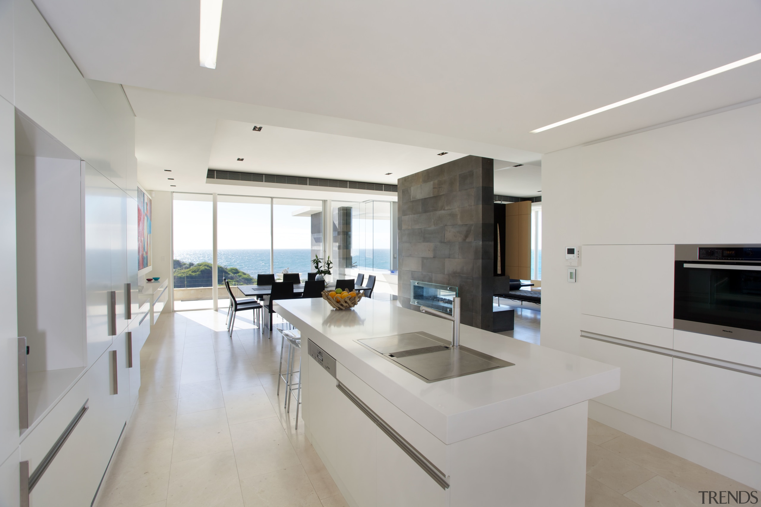 This all-white kitchen has been kept deliberately simple. apartment, architecture, countertop, house, interior design, kitchen, property, real estate, gray