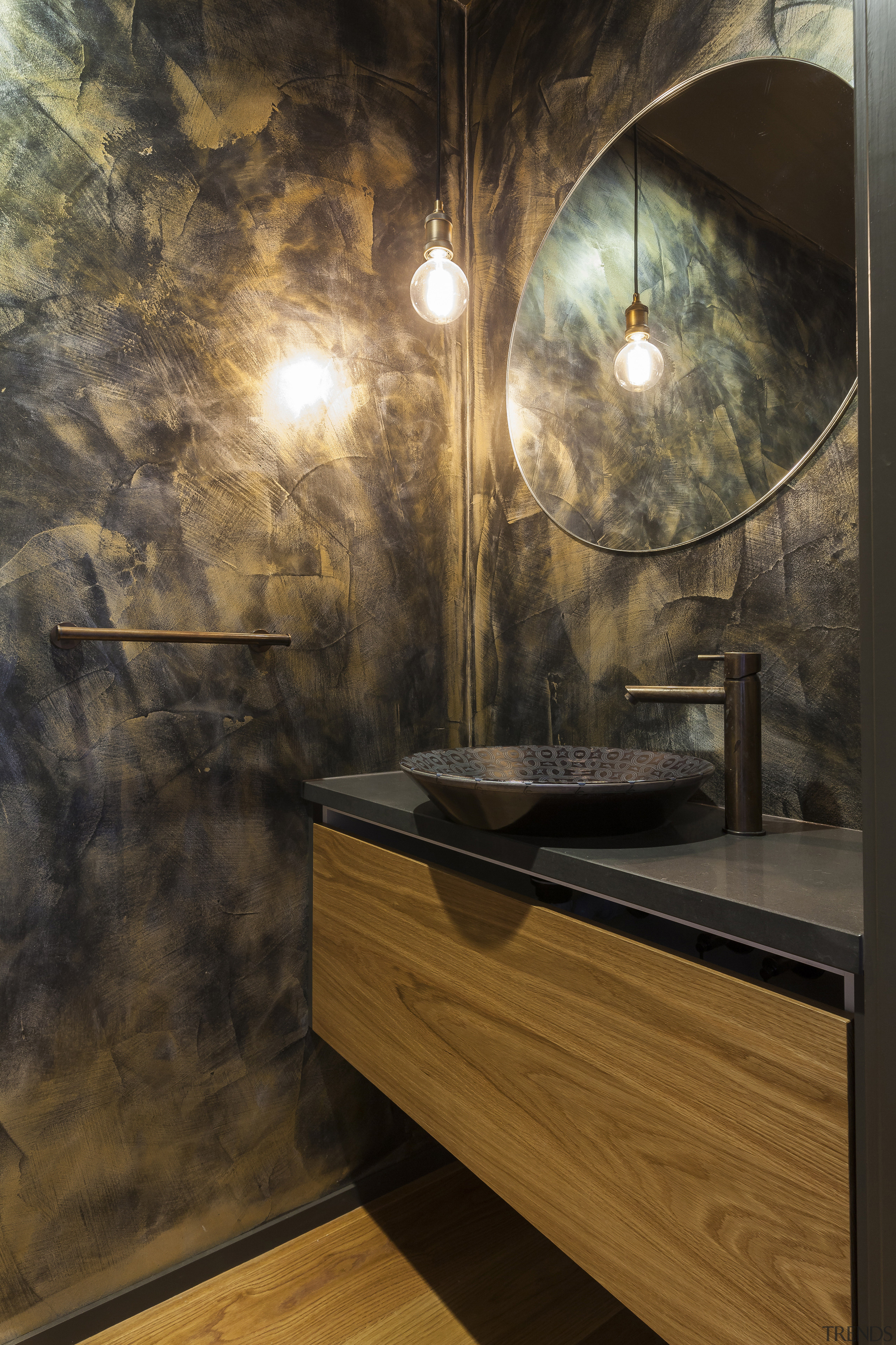 The moody master ensuite continues the interior's natural