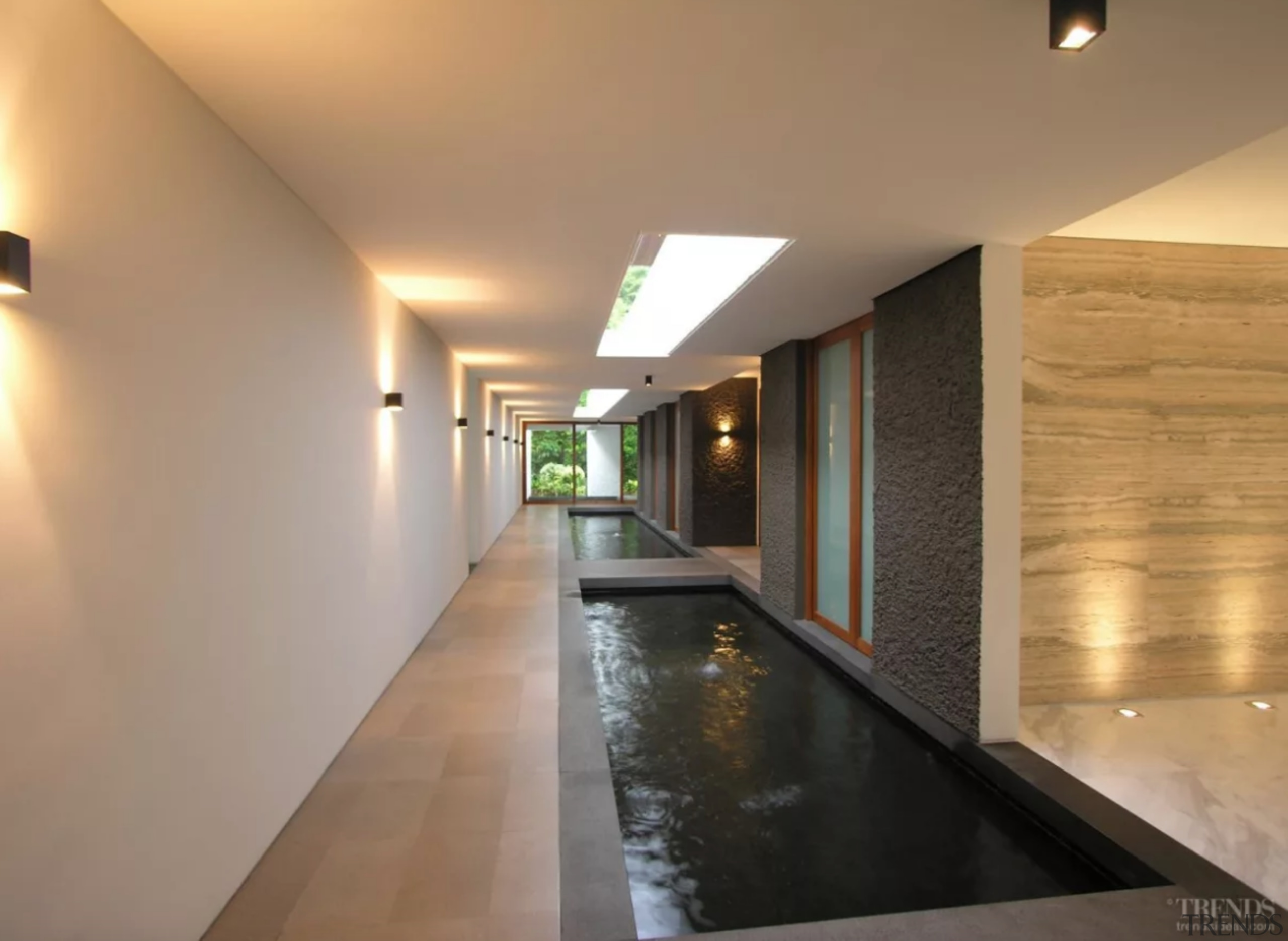 A 40m-long koi pond inside the house helps architecture, building, ceiling, floor, flooring, hall, house, interior design, lighting, lobby, property, real estate, room, wall, orange, brown