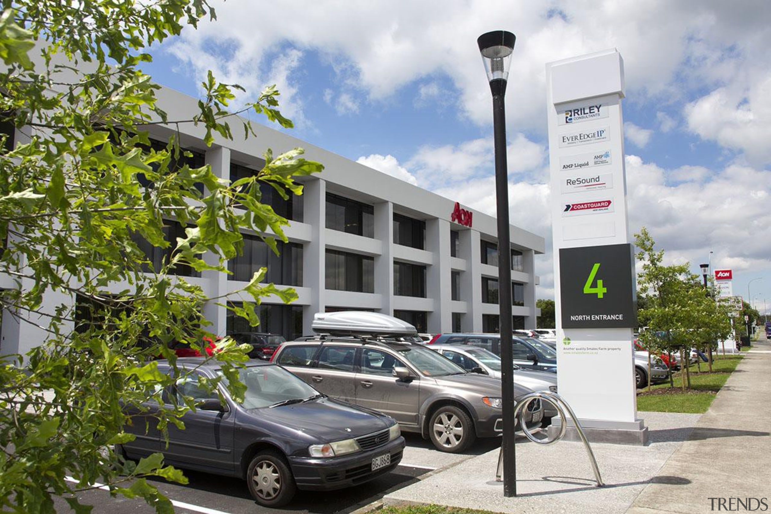 MERIT WINNER2 and 4 Fred Thomas Drive (3 building, car, family car, luxury vehicle, motor vehicle, parking, plant, real estate, sedan, tree, vehicle, white