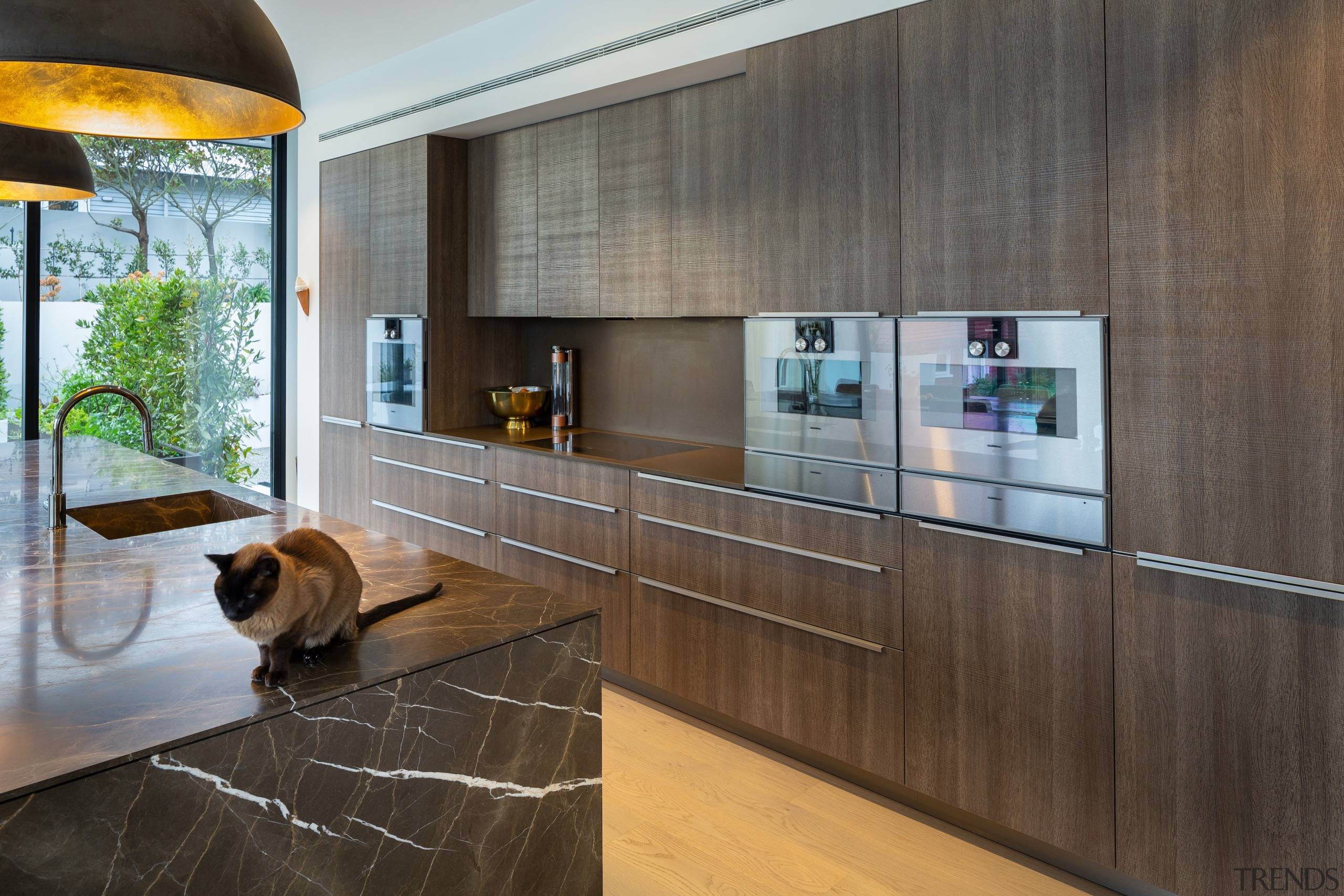 The handless upper cabinetry contributes to the kitchen's