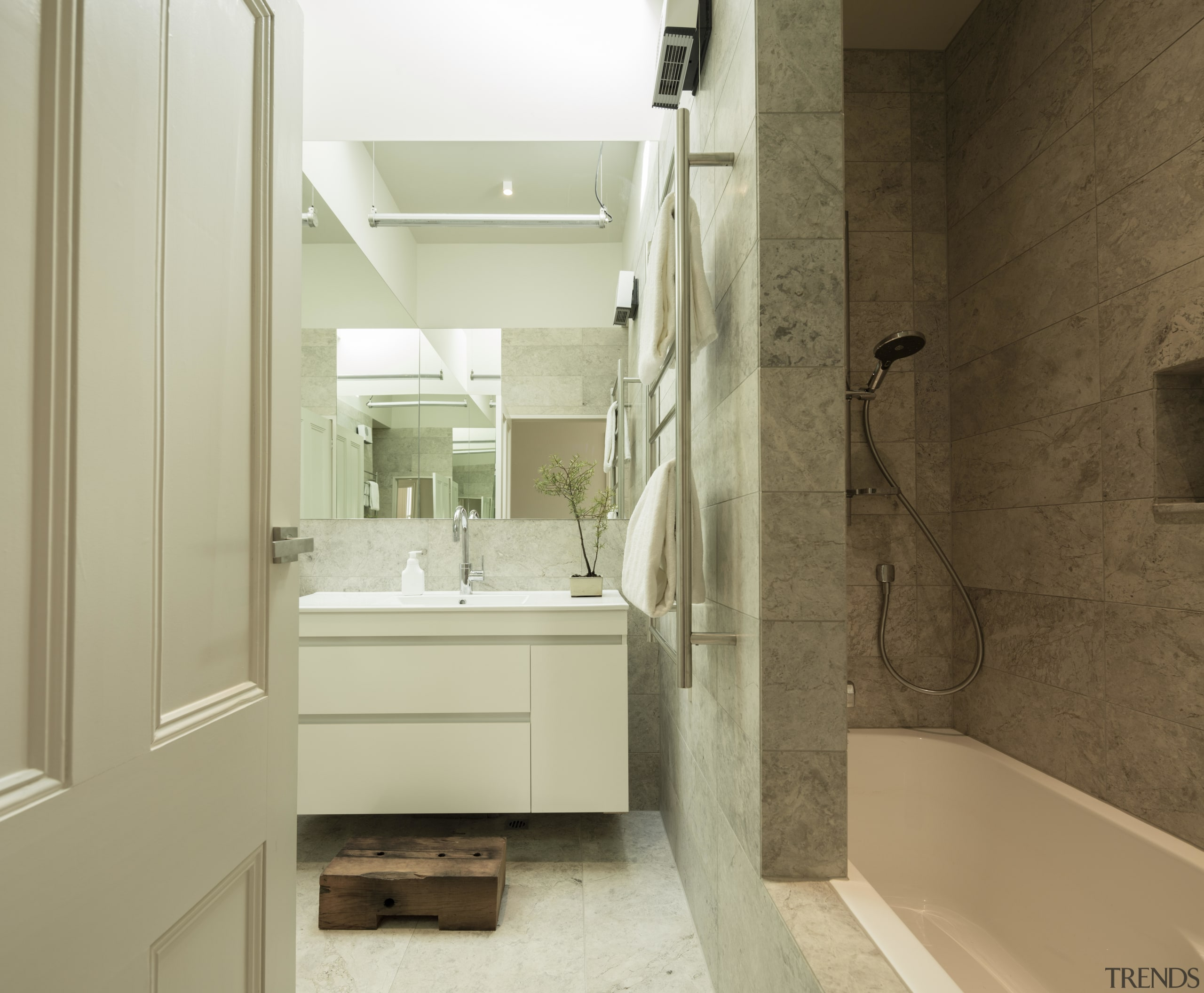 While traditional detailing was generally retained in this bathroom, bathroom accessory, bathroom cabinet, floor, home, interior design, room, sink, brown, yellow