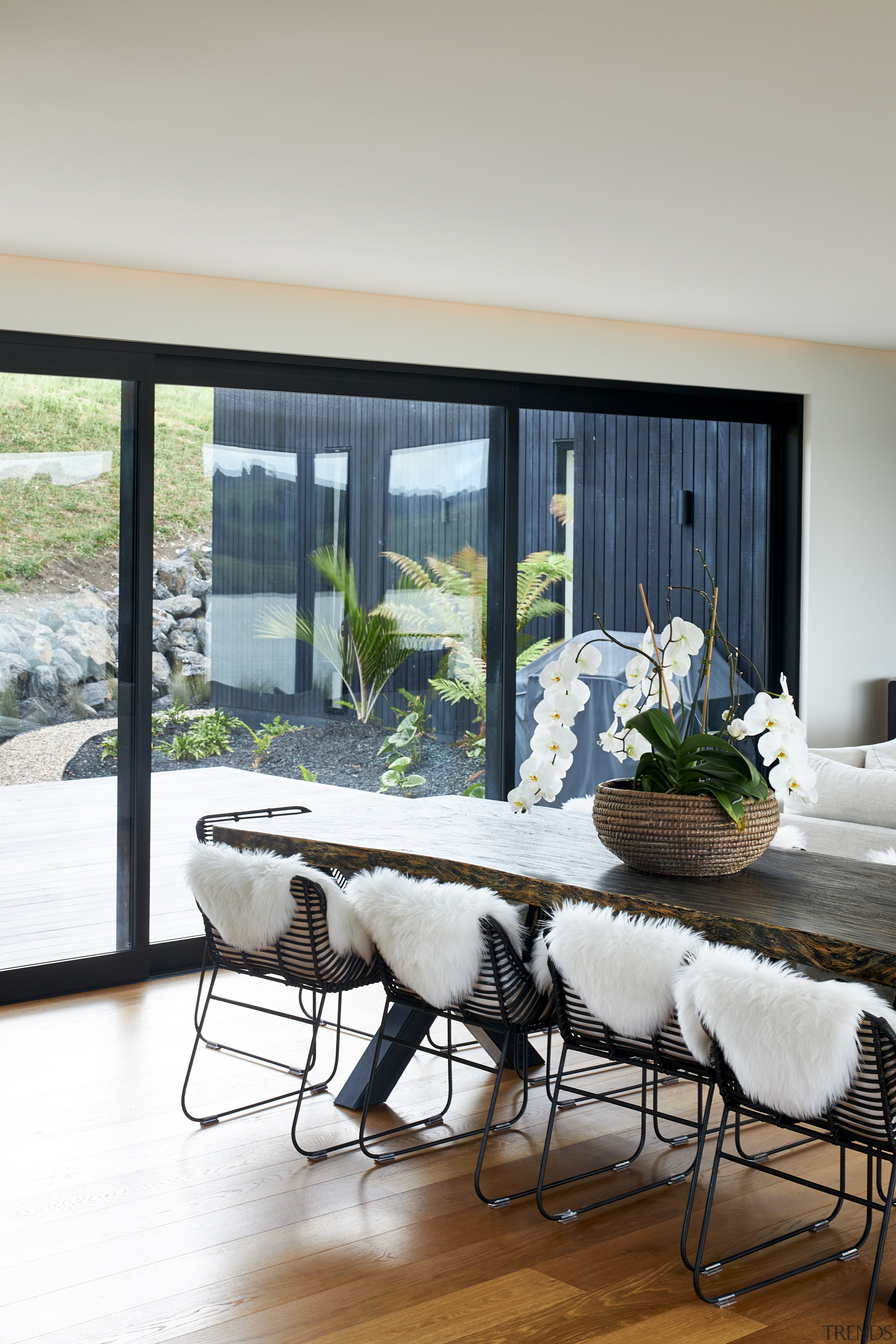 The choice of black window joinery helps frame