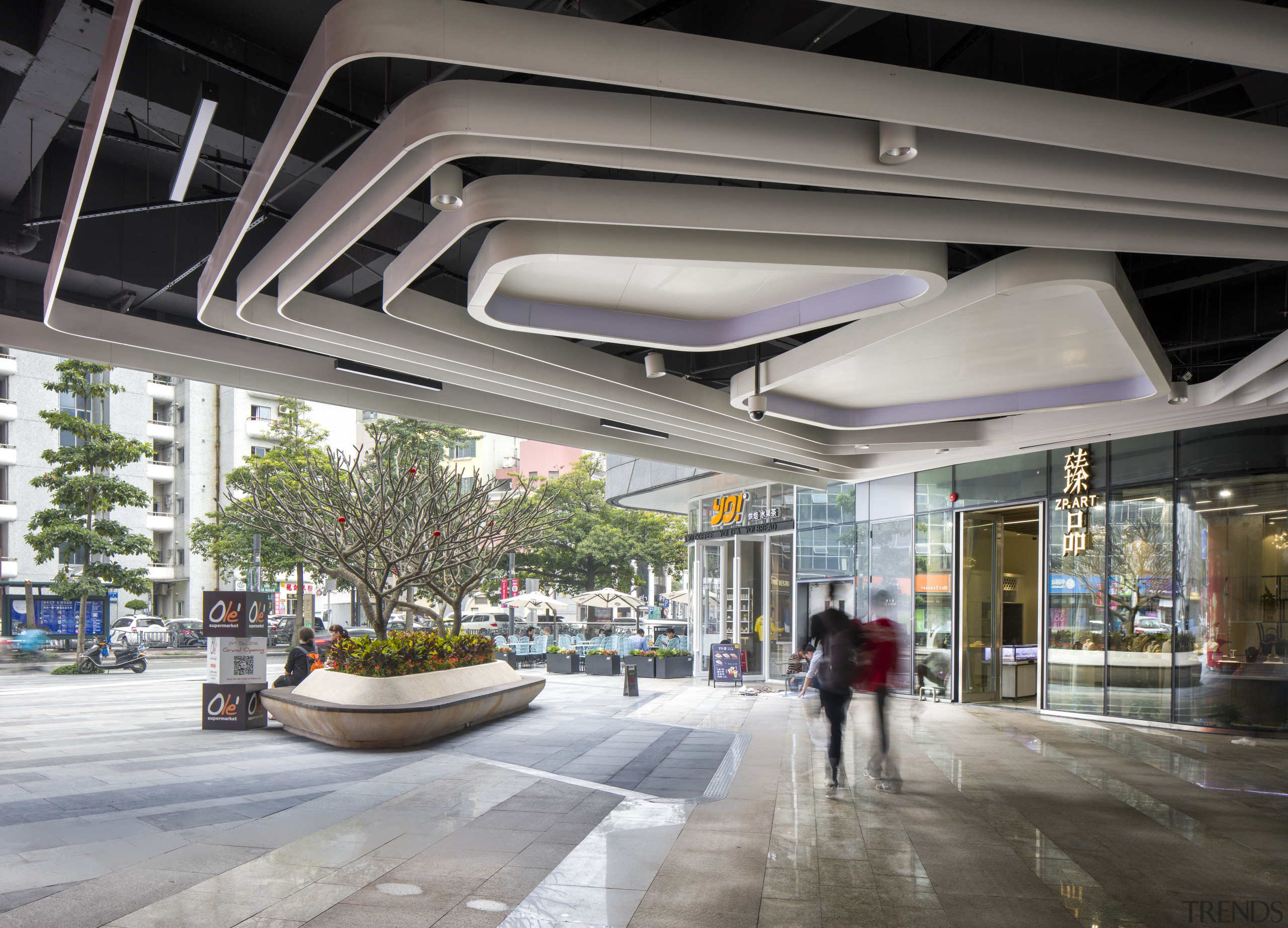 The Shekou Gateway One mall is unusual in building, lobby, metropolitan area, mixed use, shopping mall, gray
