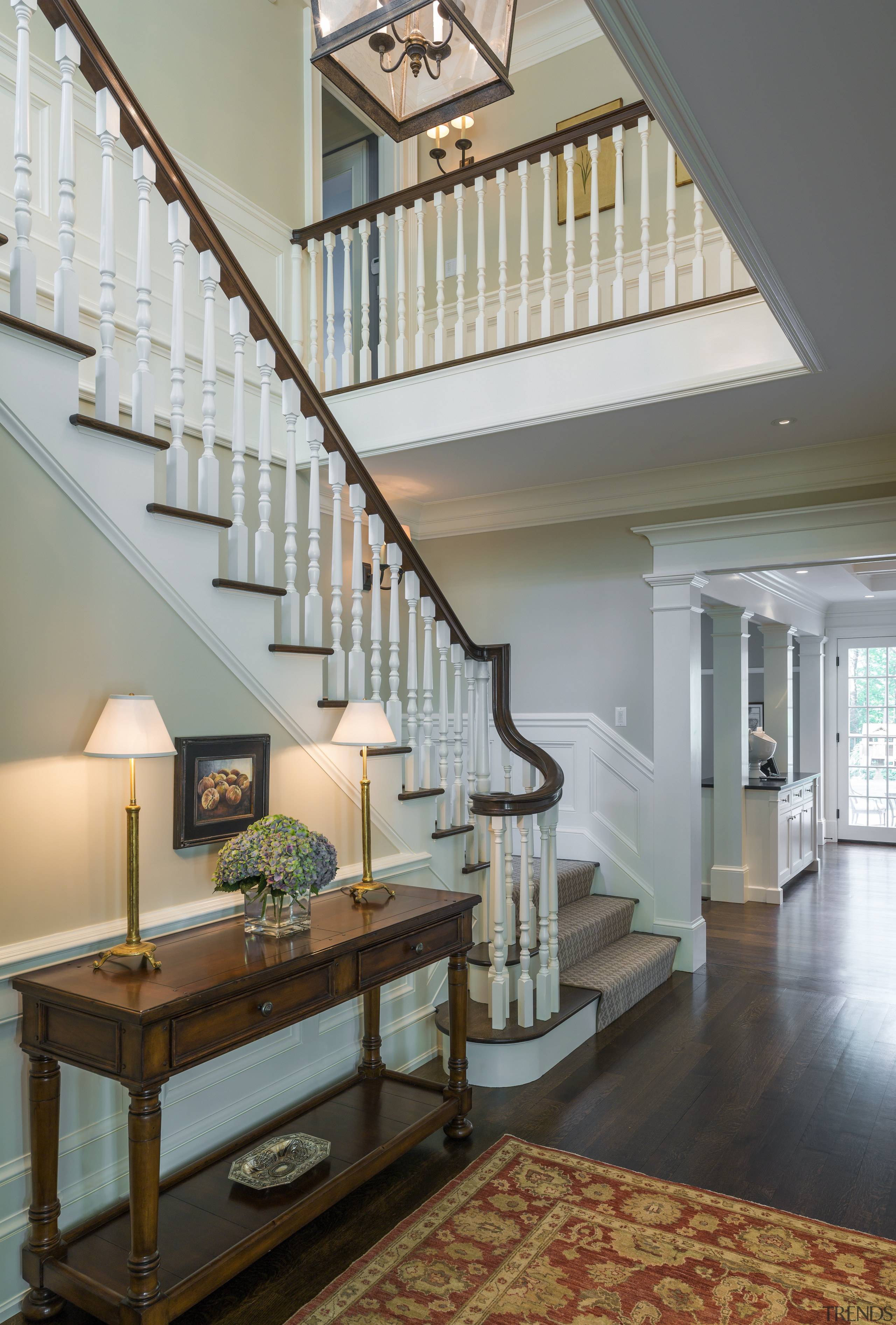 Traditional balustrading is a feature of the central architecture, baluster, ceiling, daylighting, estate, floor, flooring, handrail, hardwood, home, interior design, living room, lobby, real estate, stairs, wall, gray