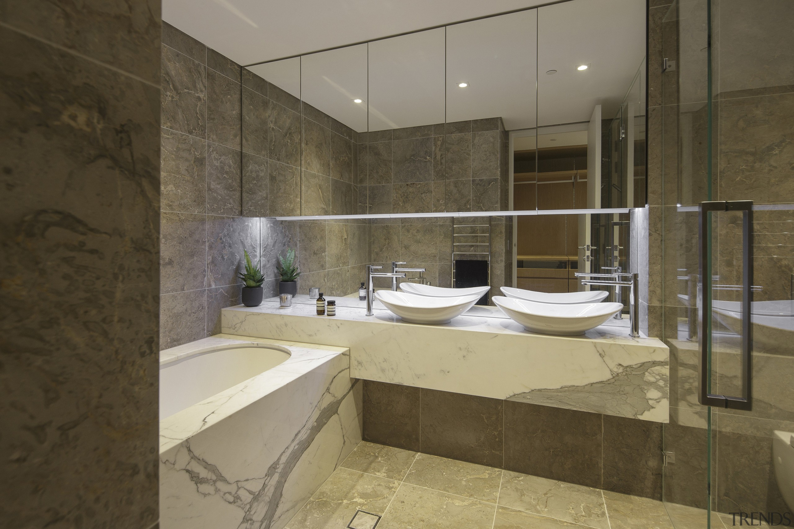 This marble-clad master bathroom has double vanities and architecture, bathroom, estate, interior design, property, room, brown