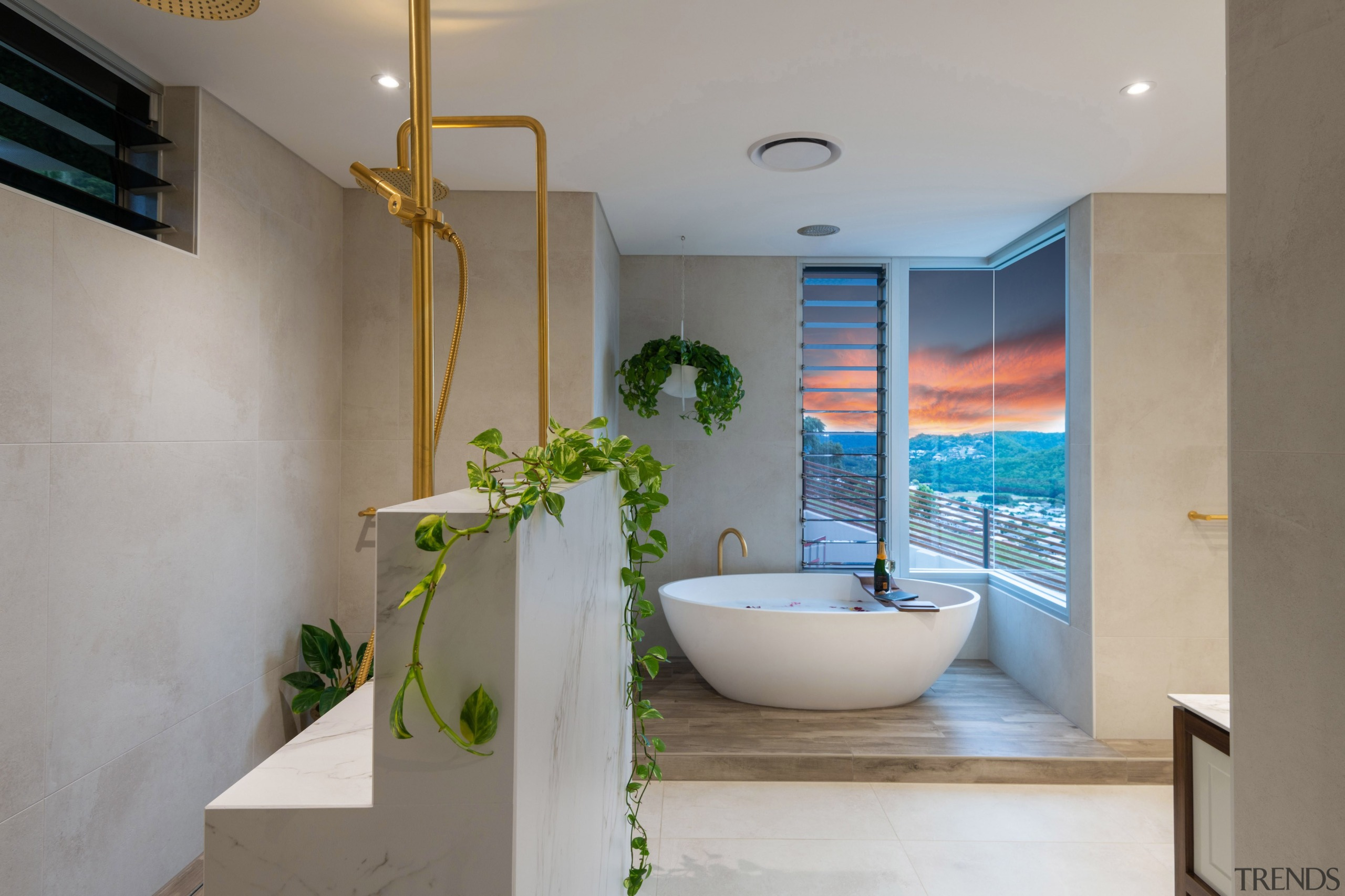 A half wall in the shower area provide