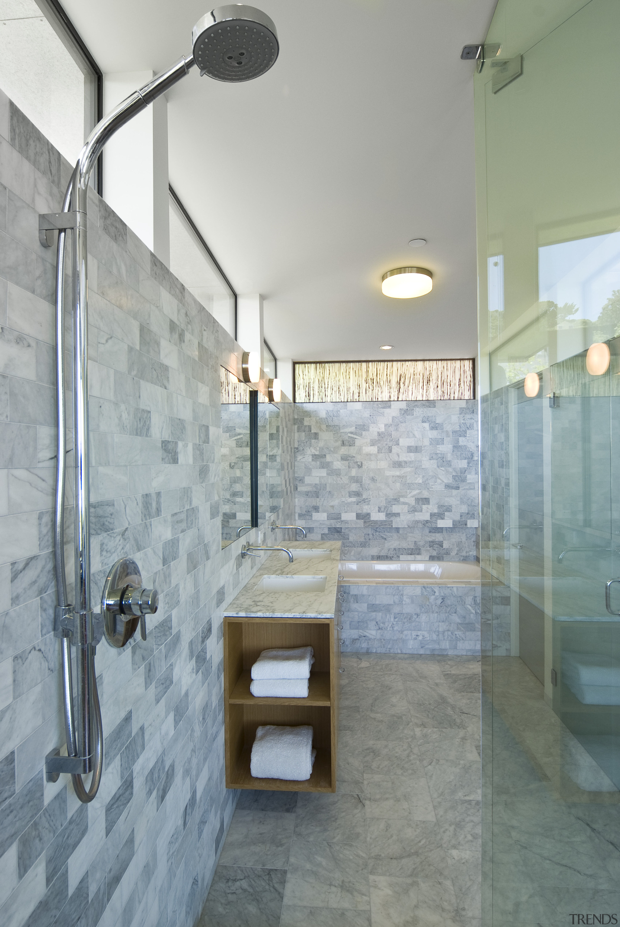 Trends] | View of a bathroom which features a marble tiled shower ...