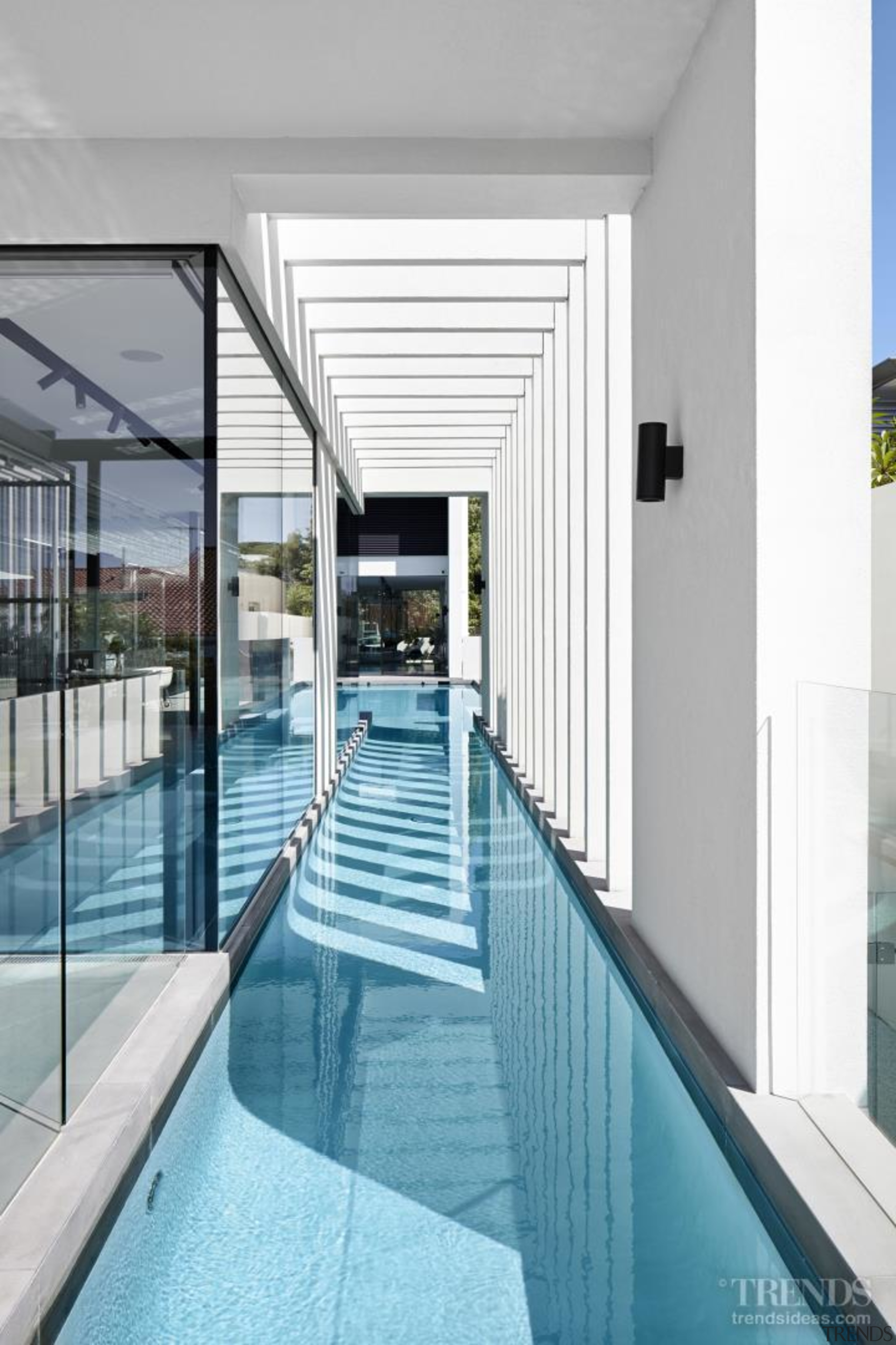 This 25m-long pool extends alongside the informal living architecture, condominium, daylighting, glass, leisure centre, property, real estate, swimming pool, white, teal