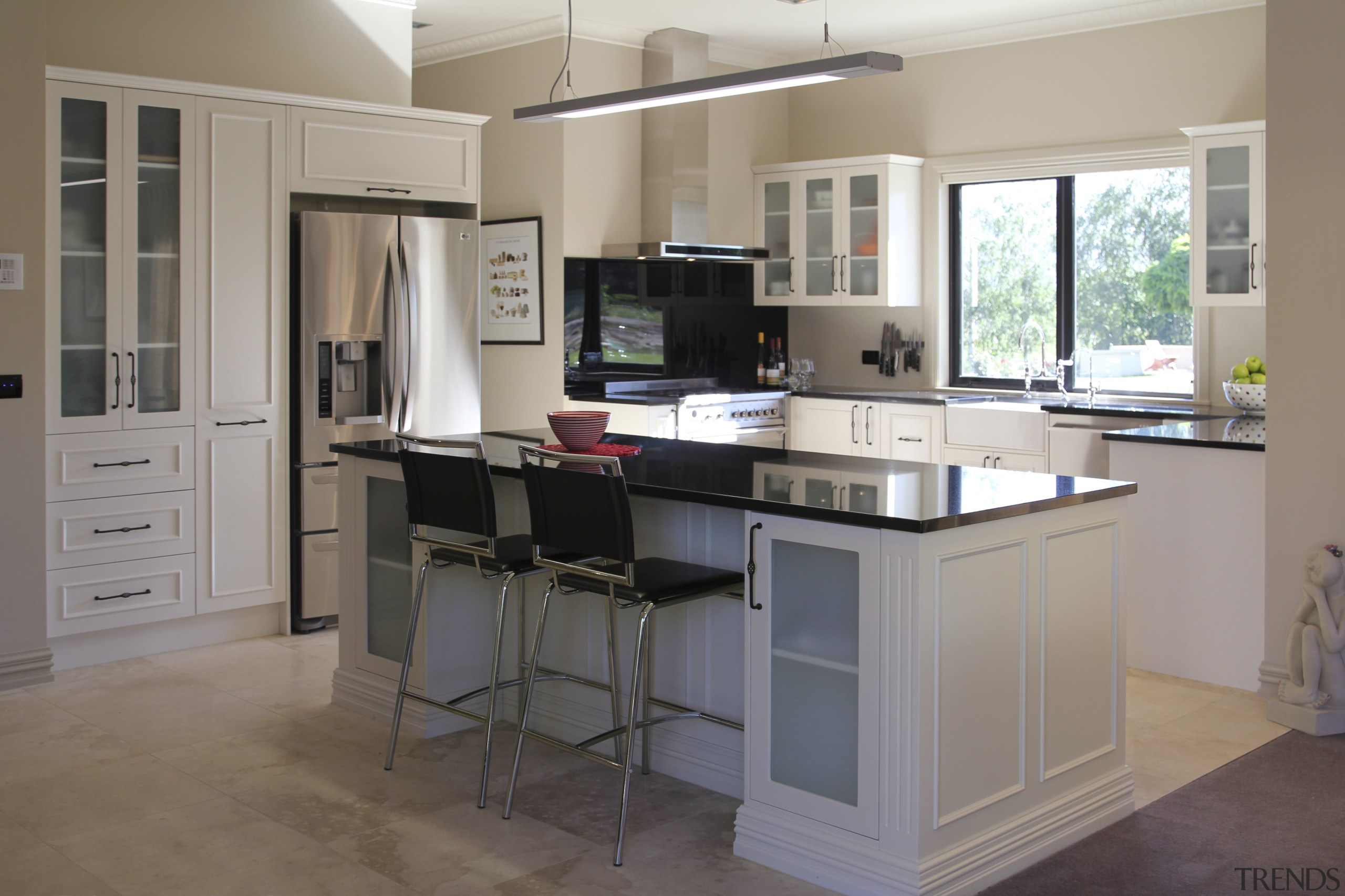 View of a kitchen designed and manufactured by cabinetry, countertop, cuisine classique, desk, floor, furniture, kitchen, room, gray