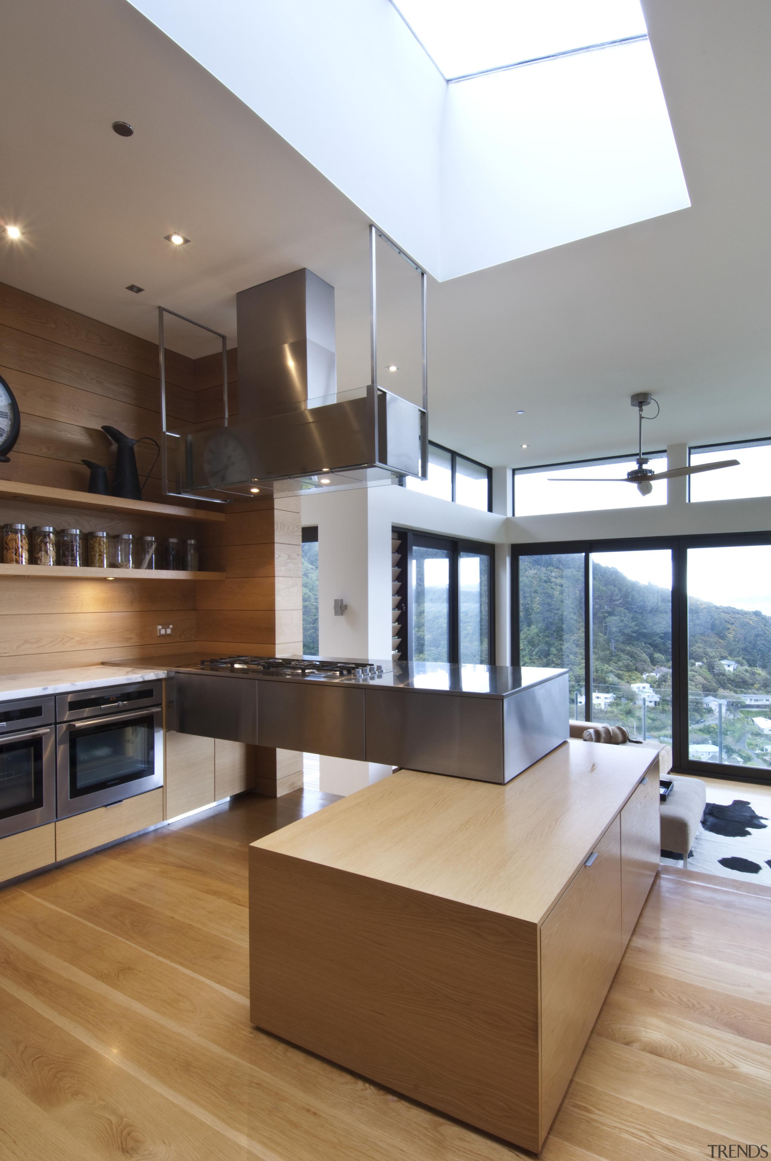 Raised floor kitchen. Stainless steel Binova cooktop. American architecture, cabinetry, countertop, cuisine classique, daylighting, floor, hardwood, interior design, kitchen, living room, real estate, wood flooring, brown