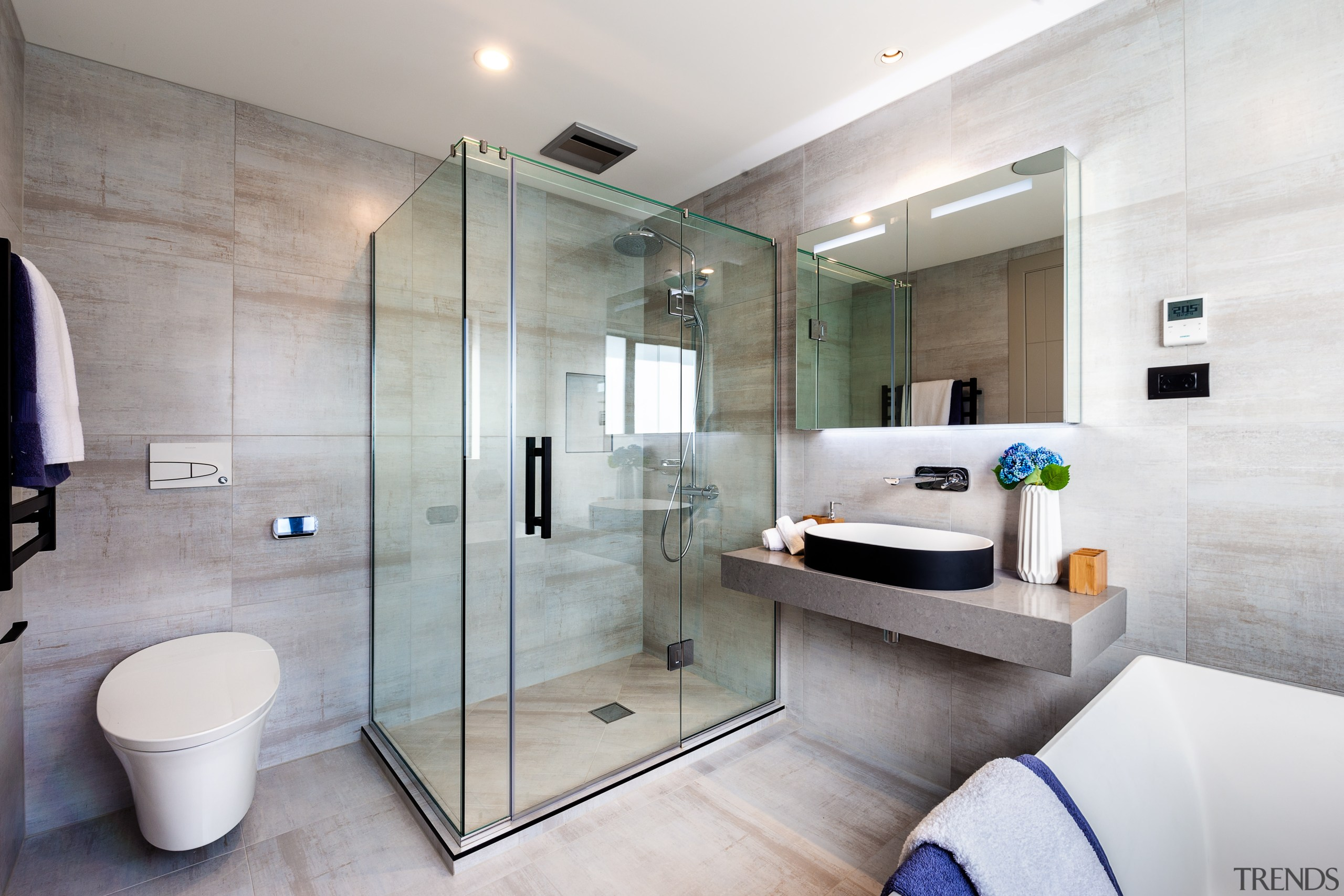 In this showhome by Chancellor Construction, the detailing bathroom, tile floor, home, black detail, shower enclosure, hansgrohe, Galaxy Tiles, Chancellor Construction
