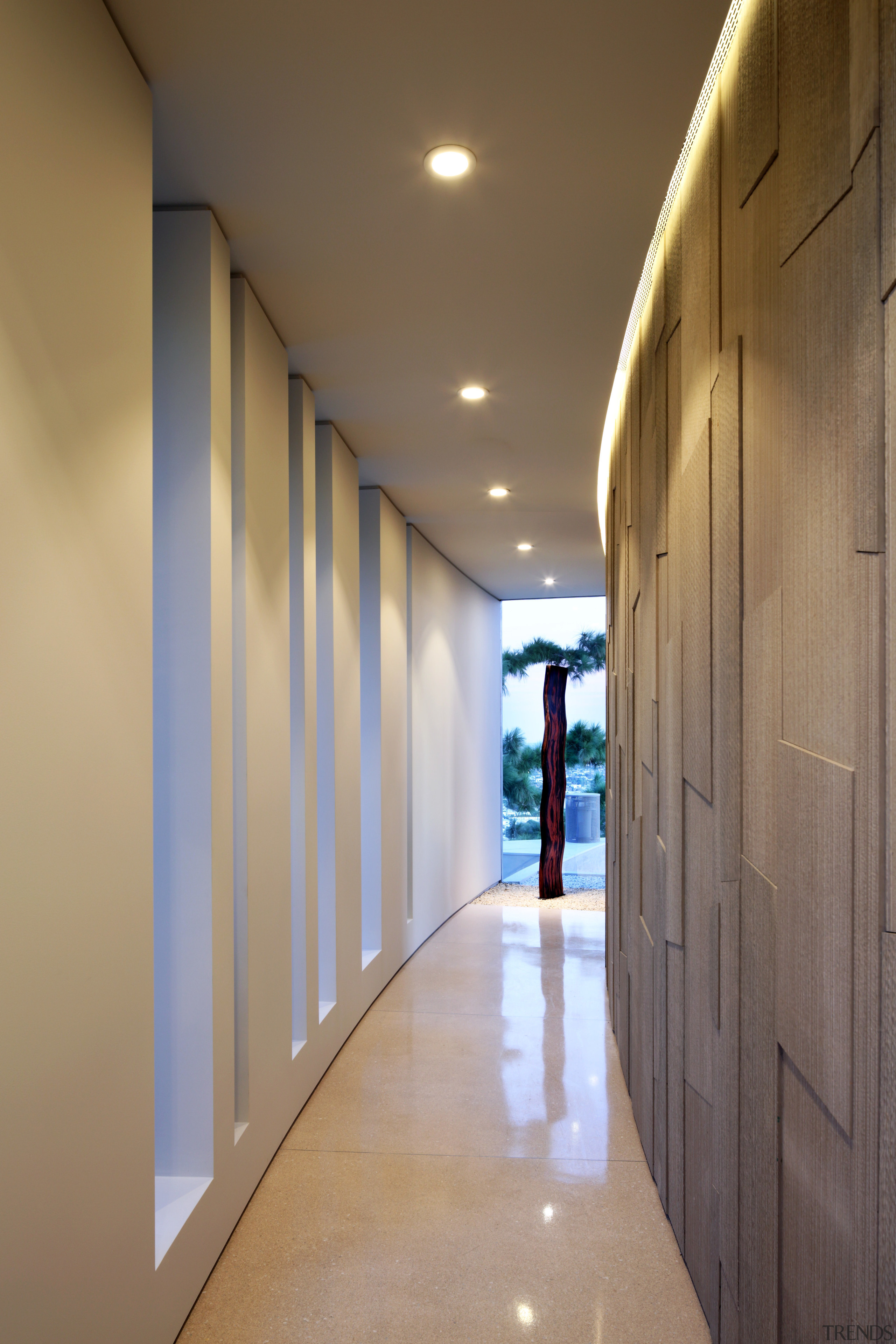 Architecture without straight lines. Nearly every surface in apartment, architecture, ceiling, daylighting, floor, hall, home, house, interior design, lighting, lobby, real estate, wall, wood, brown