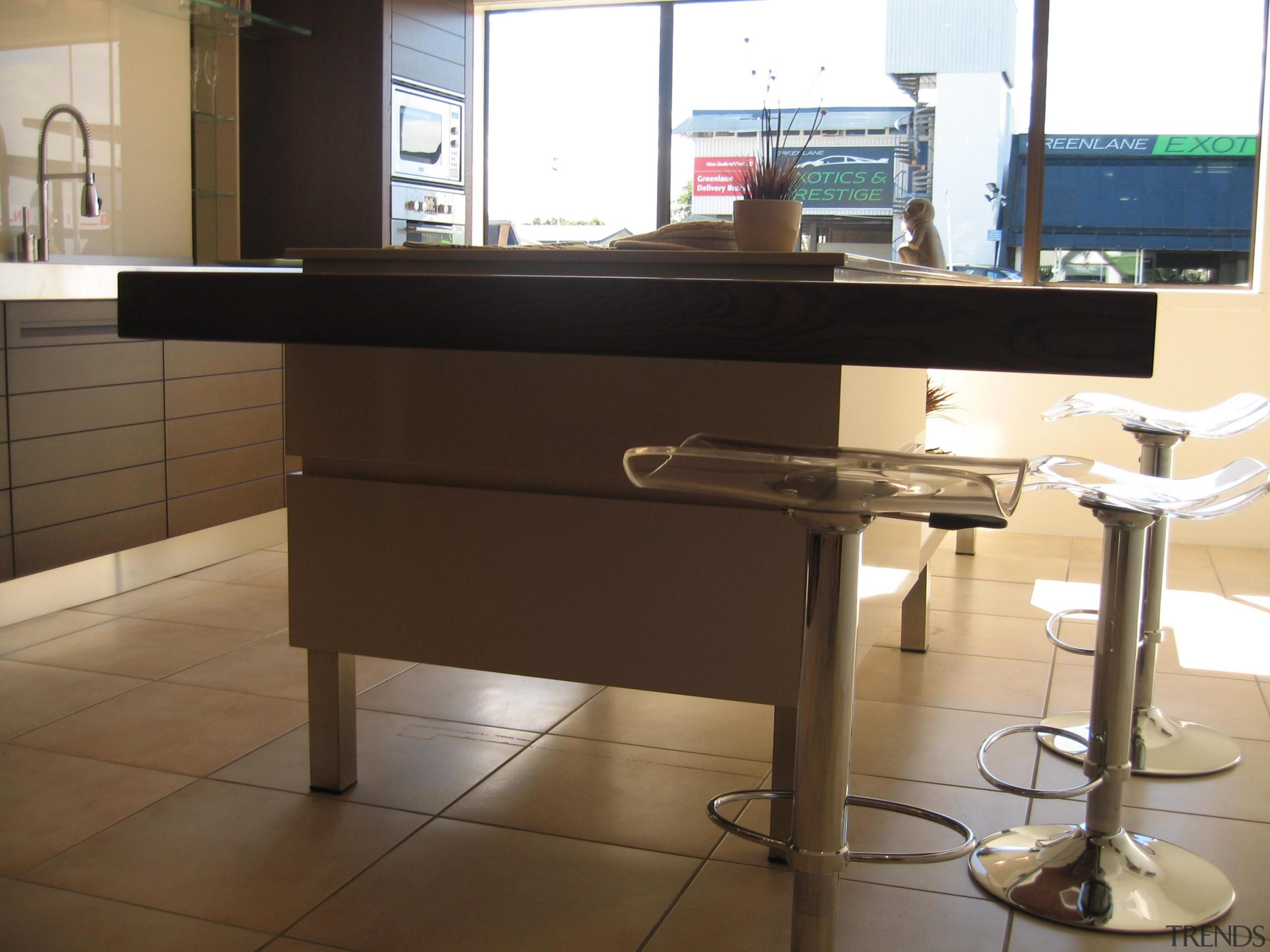 Greenlane - countertop | desk | floor | countertop, desk, floor, flooring, furniture, kitchen, table, black, brown