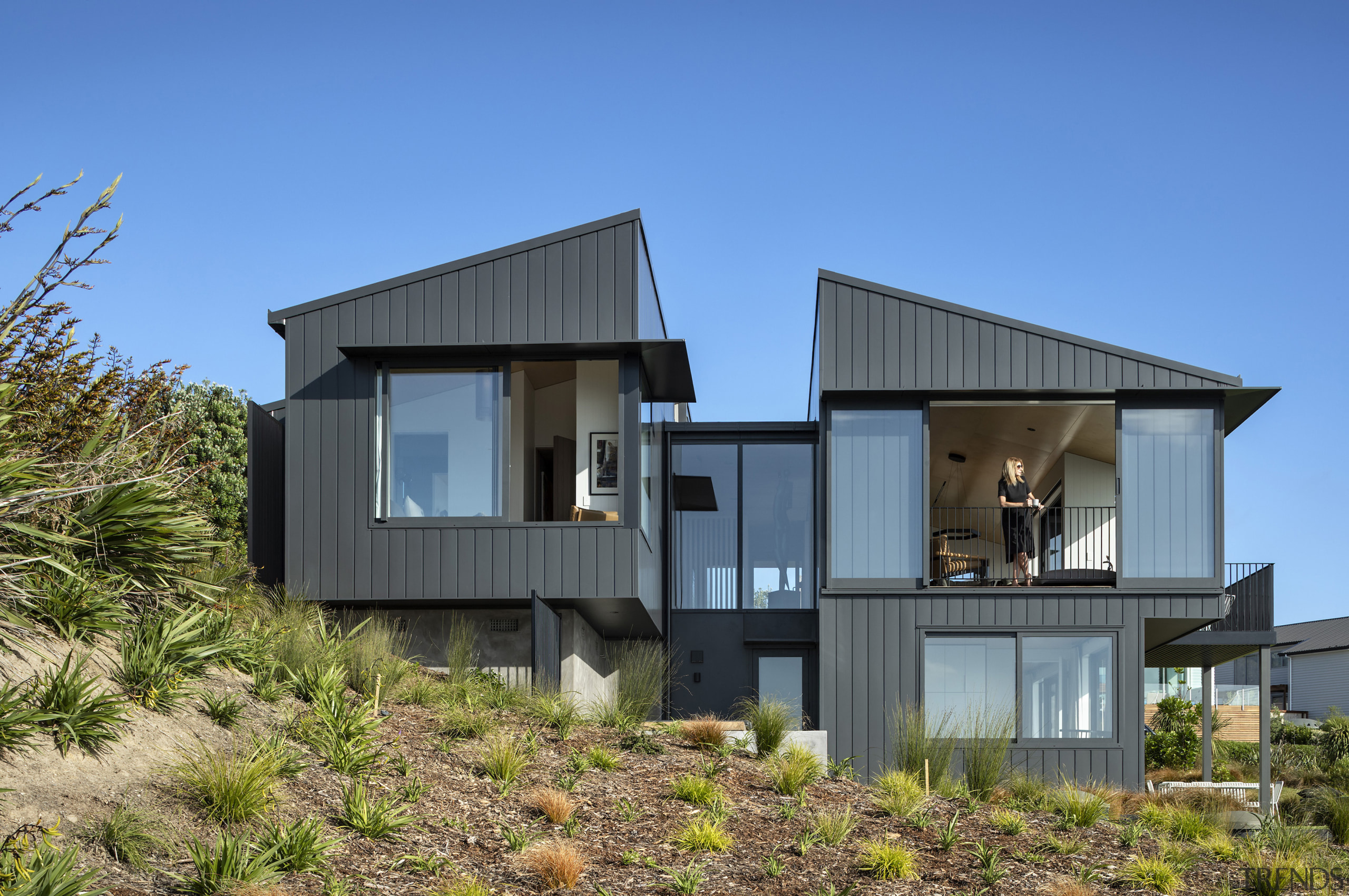 The ends of the coastal home's two wings