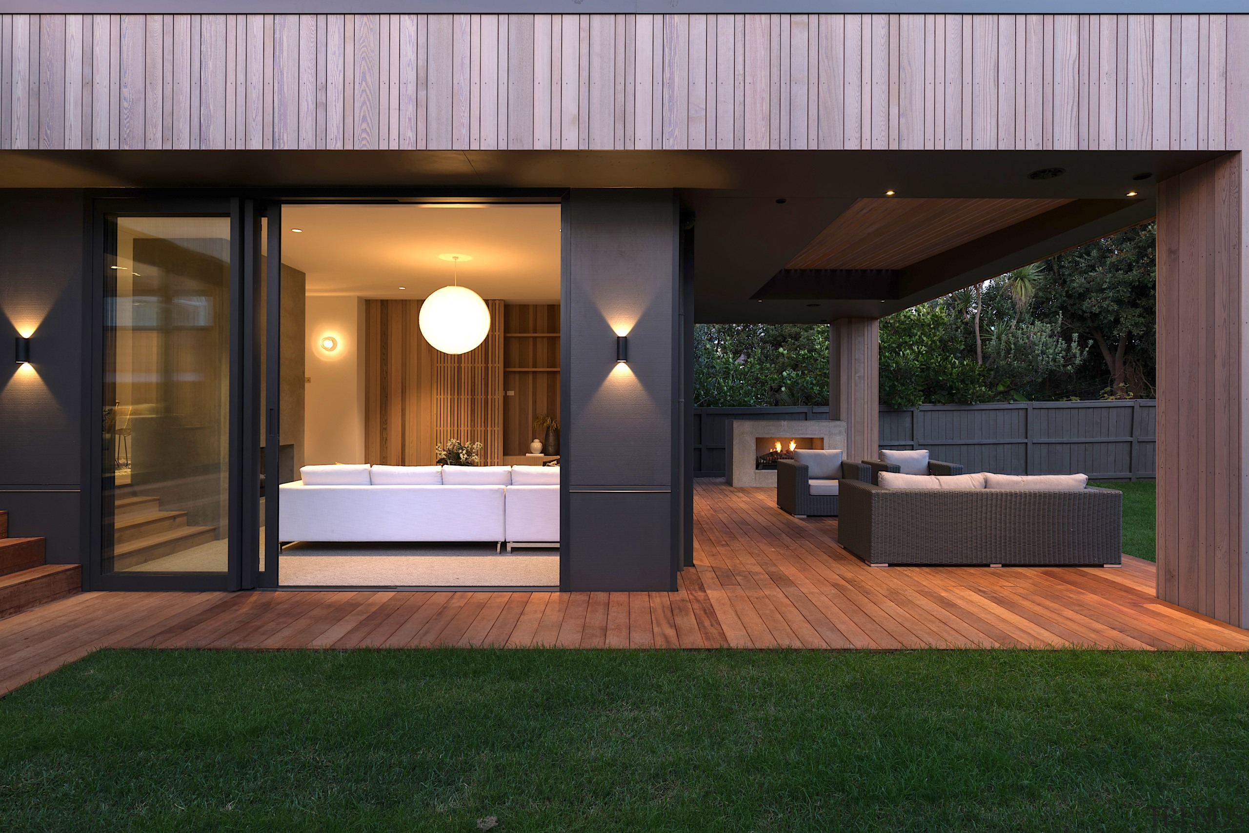 The home's generous rear outdoor living space continues