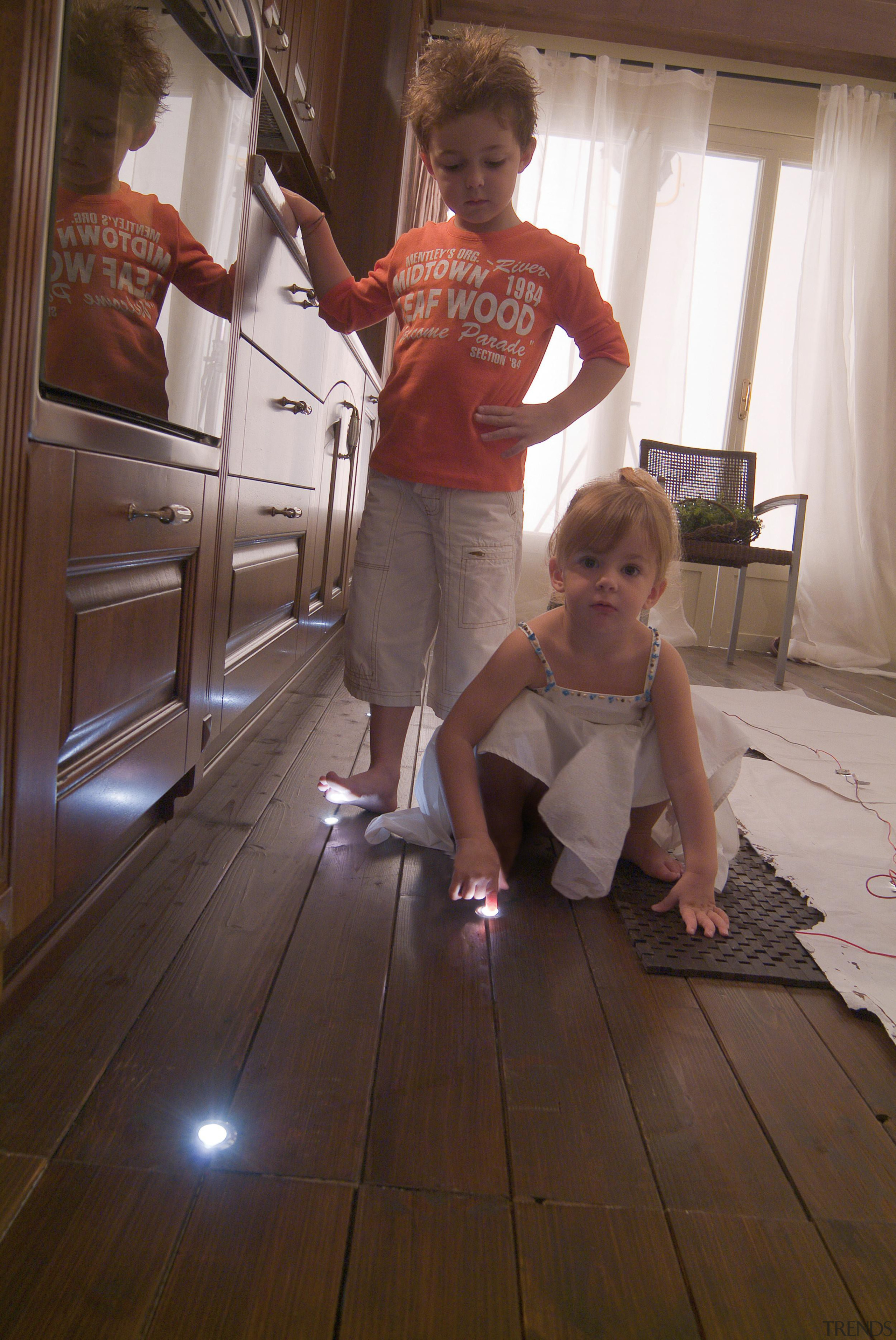 LED Lights - child | day | floor child, day, floor, flooring, fun, girl, hardwood, house, human body, leg, room, shoulder, sitting, standing, trunk, wood, wood flooring, brown, gray