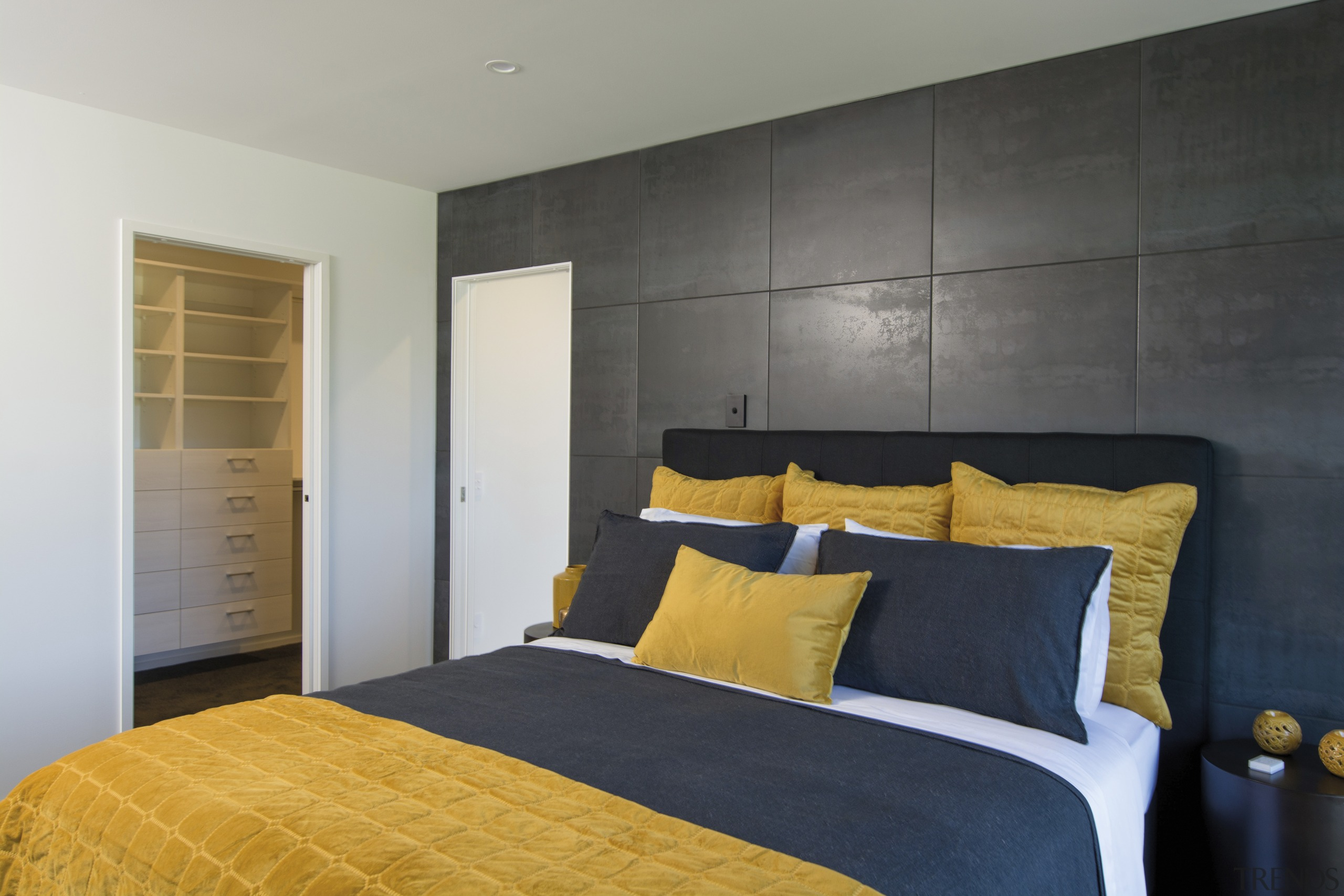 A panelled wall behind the bedhead is a architecture, bed, bedroom, home, interior design, master bedroom, black, mustard, GJ Gardner Homes