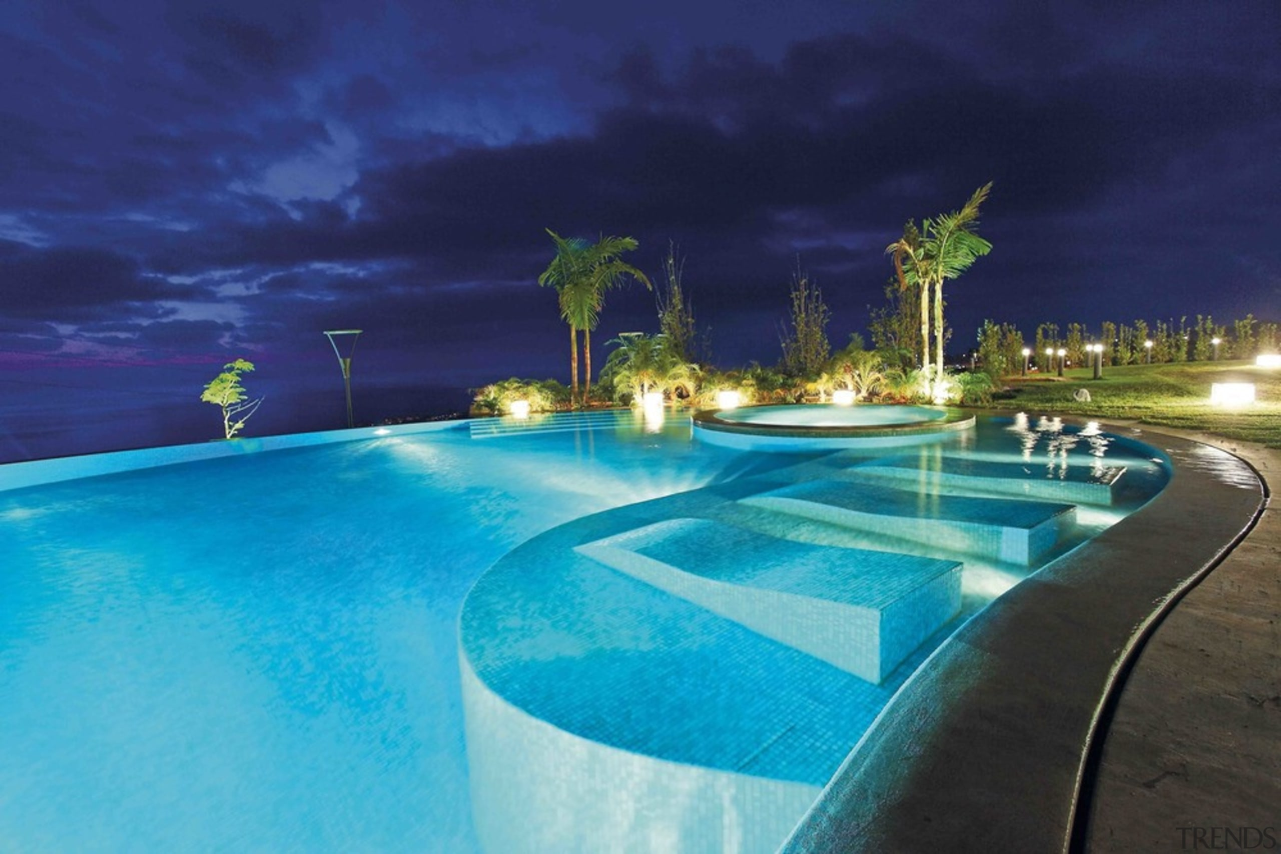 This pool house is sense-ational - architecture   architecture, building, estate, hotel, house, leisure, lighting, night, property, real estate, resort, resort town, sky, spa town, swimming pool, tree, vacation, villa, blue, teal