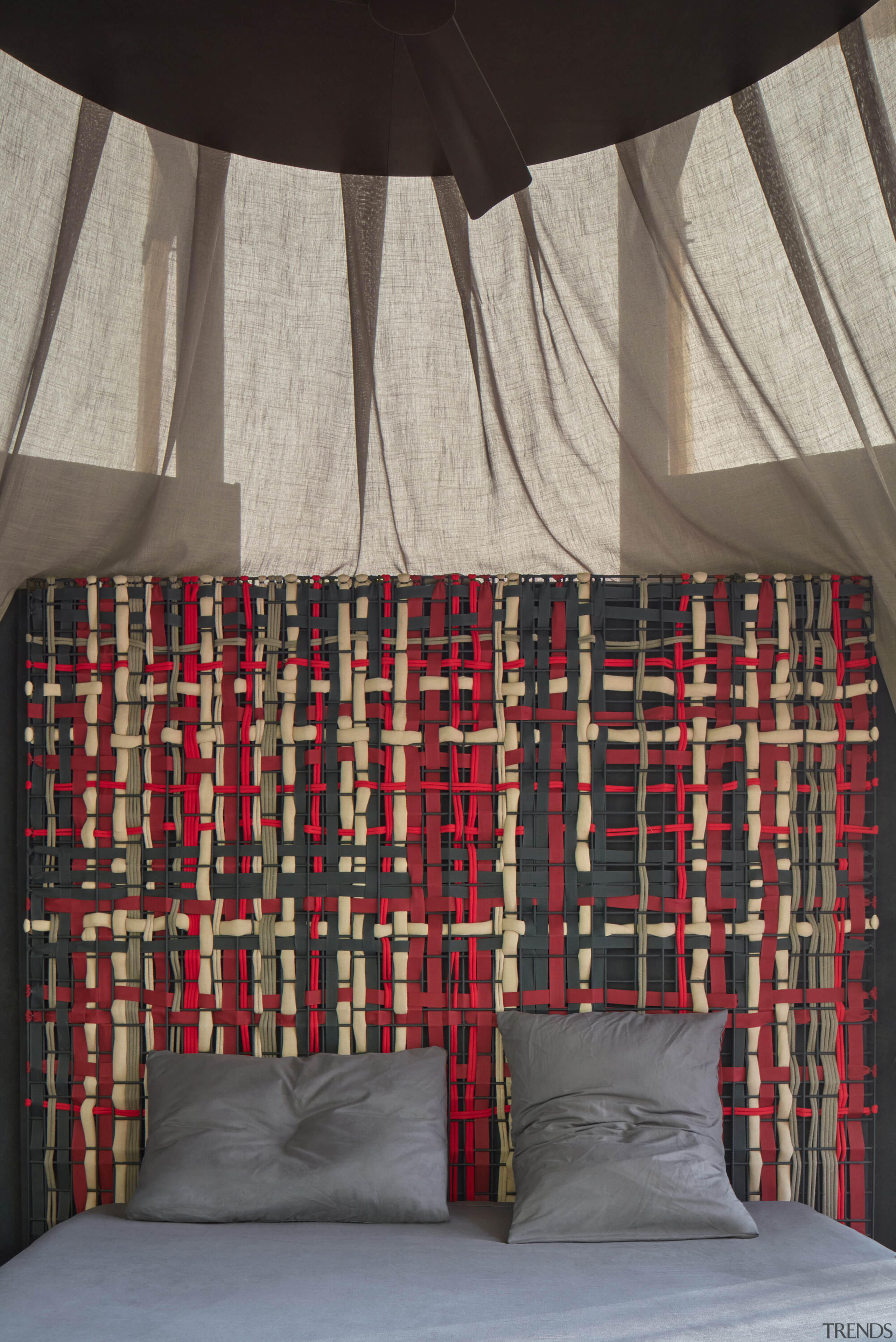 The artistic design for the woven headboards suggests