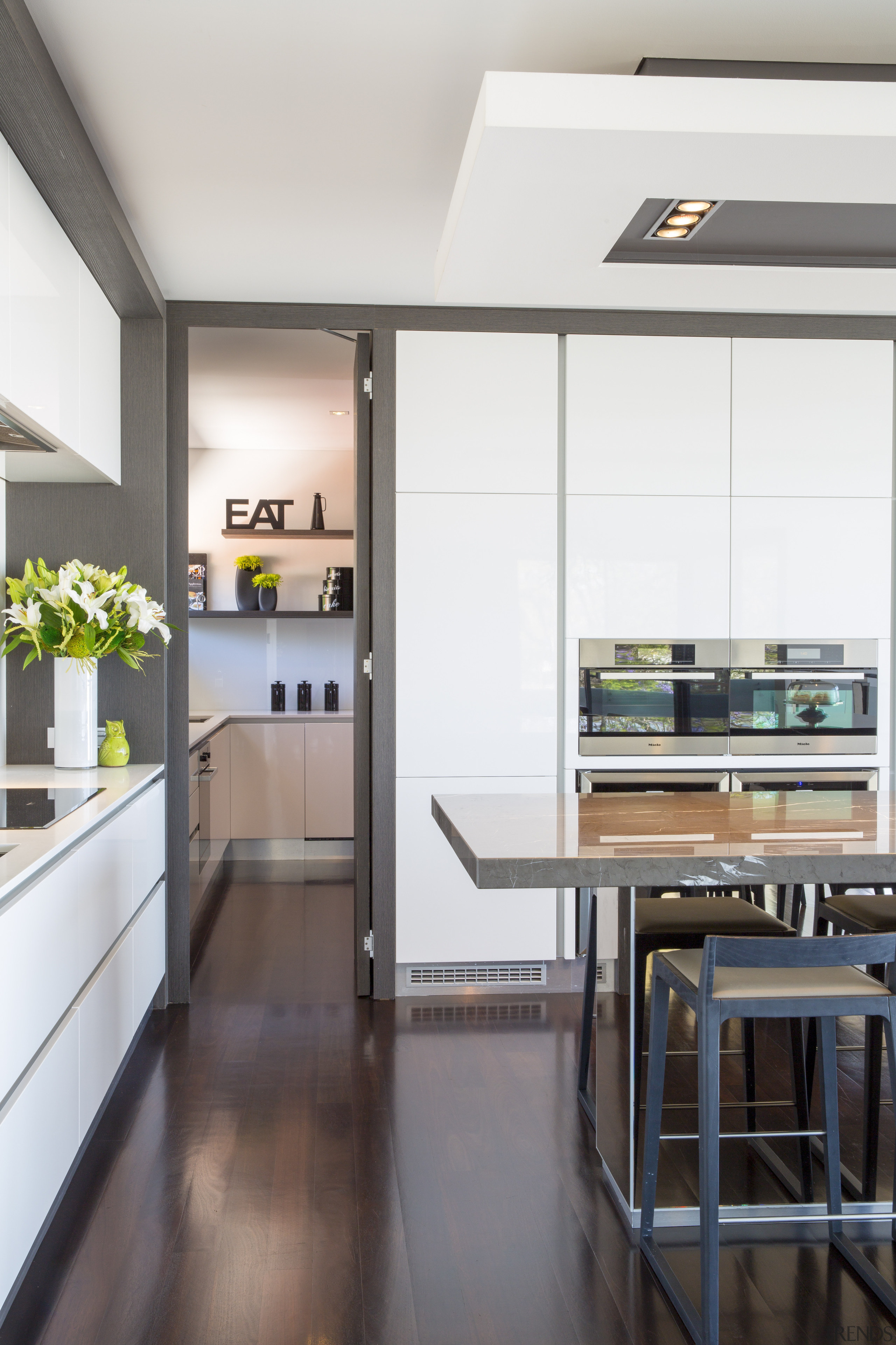 Contemporary kitchen with marble benchtop, handleless cabinetry and countertop, interior design, kitchen, white