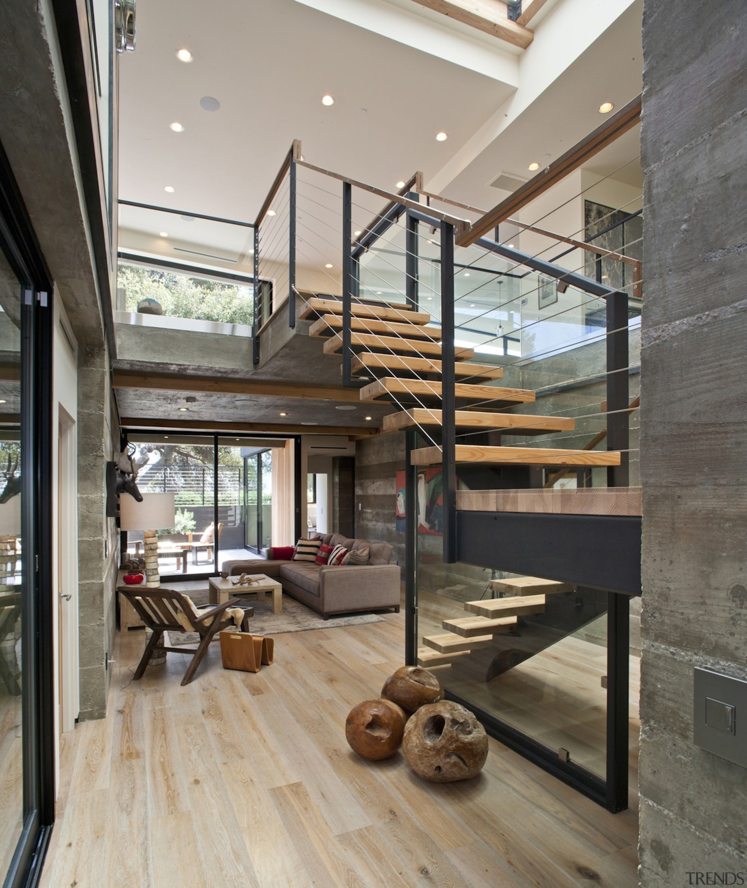 The staircase is the centrepiece of this central floor, handrail, house, interior design, stairs, gray