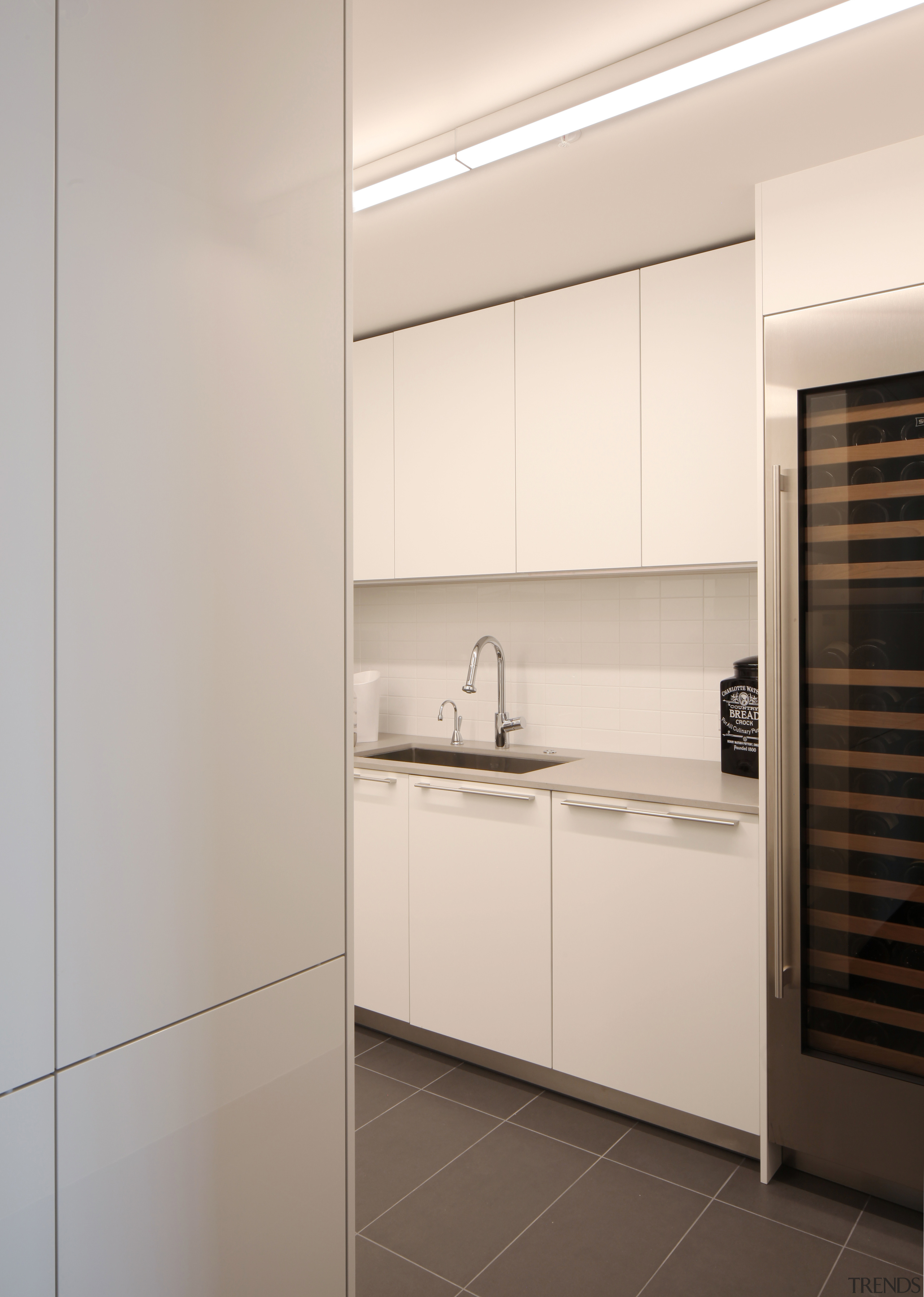 ​​​​​​​In this apartment, the well-set-up kitchen is served cabinetry, countertop, home appliances, Apartment, kitchen, appliances, Baulthaup, Sub Zero, William Landeros,  Kitchen Distributors