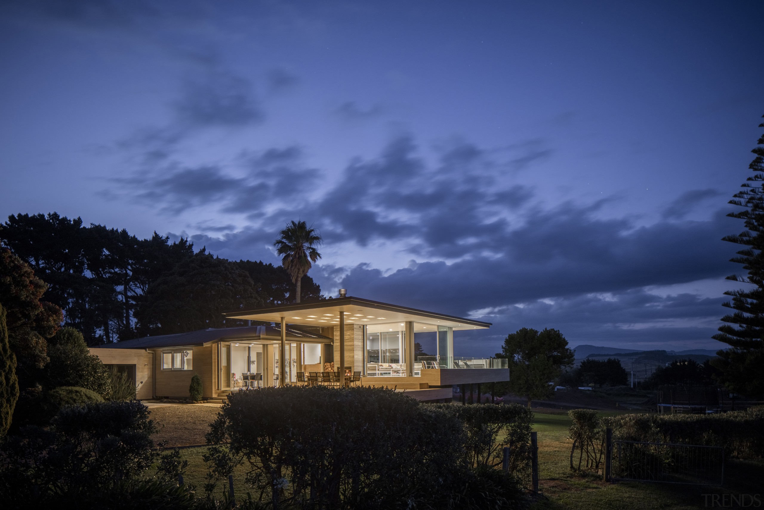 This substantial renovation of a lakeside home by architecture, atmosphere, cloud, cottage, darkness, dawn, dusk, estate, evening, farmhouse, highland, home, horizon, house, landscape, lighting, mansion, meteorological phenomenon, morning, nature, night, phenomenon, property, real estate, residential area, rural area, sky, sunlight, tree, blue, black