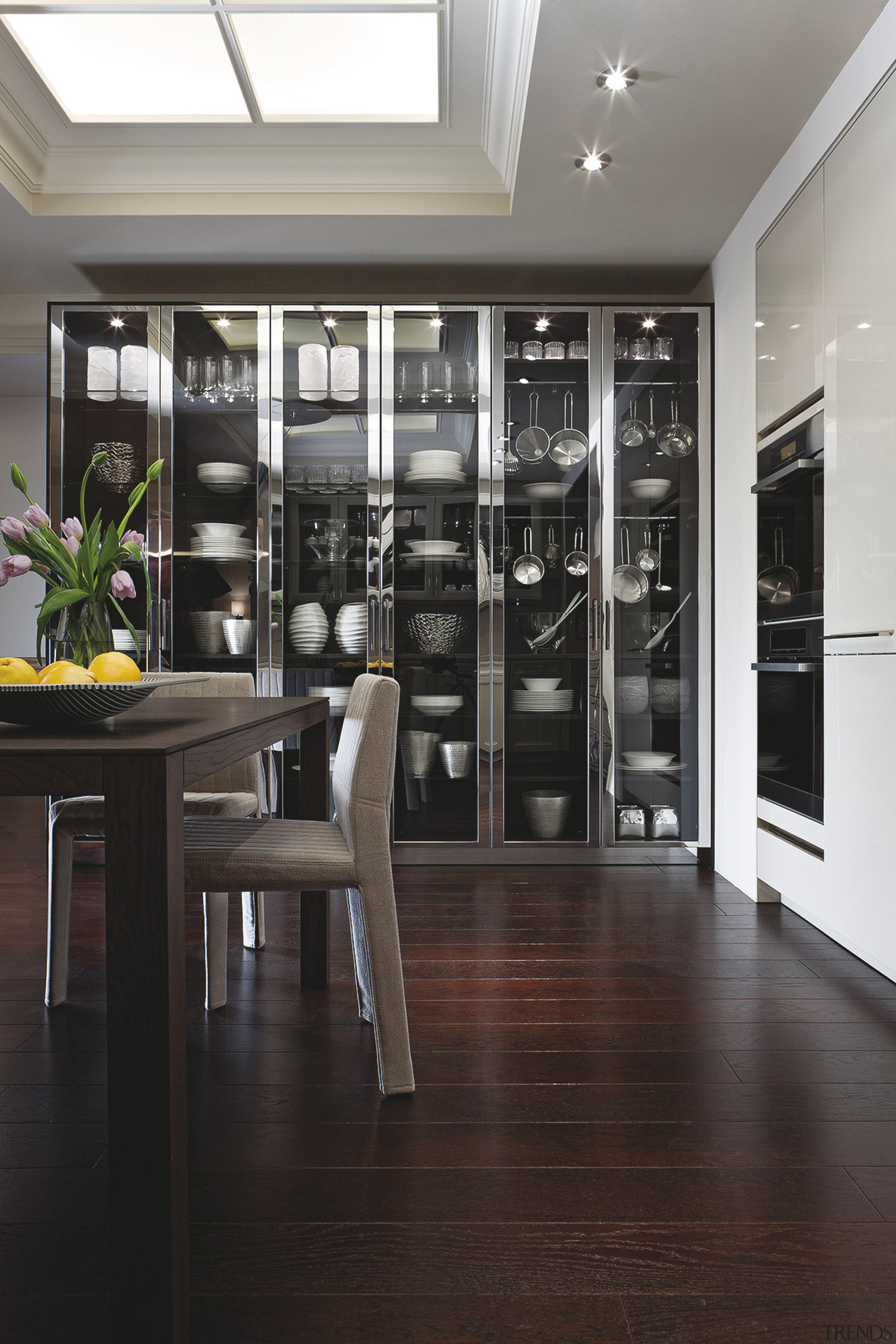 View of the BeauxArts.02 collection by SieMatic, including floor, flooring, hardwood, interior design, laminate flooring, lobby, window, wood, wood flooring, black