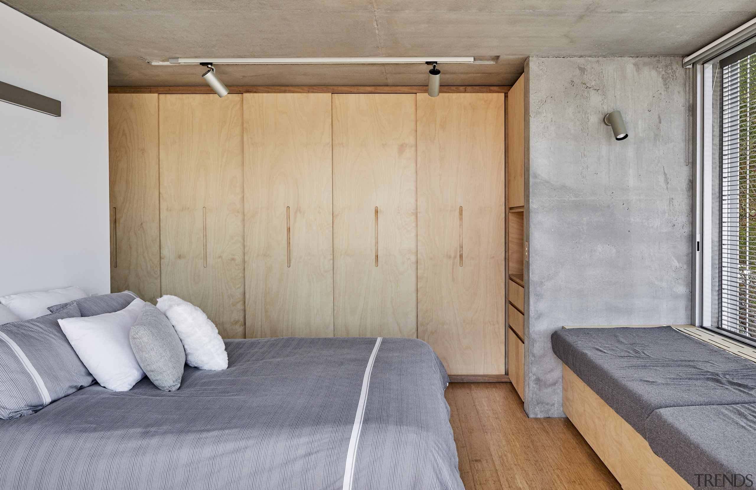 The bedrooms follow the same pared back material