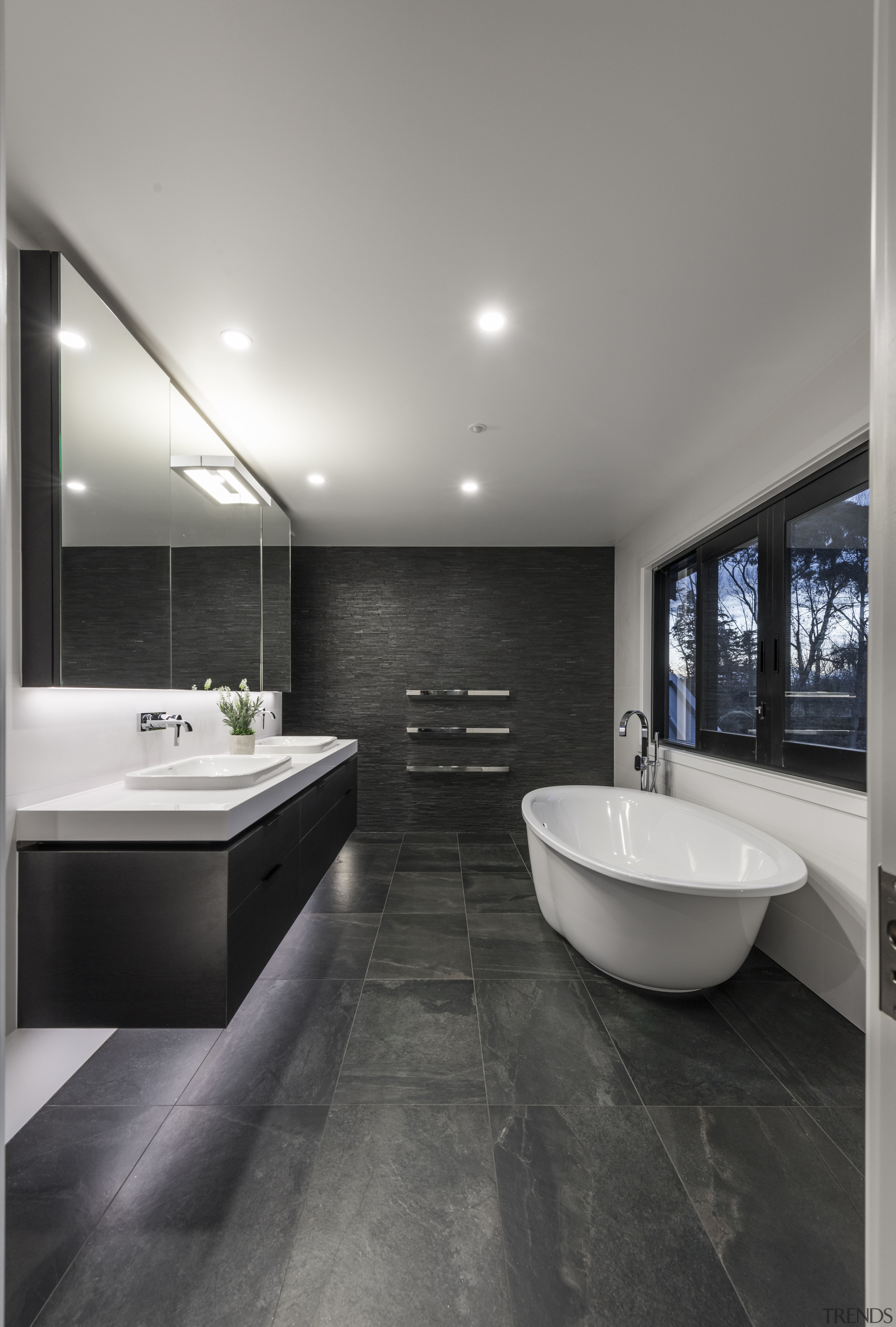 The tub is on show on entering this architecture, bathroom, ceiling, countertop, floor, flooring, house, interior design, real estate, room, sink, tile, wall, wood flooring, gray, black