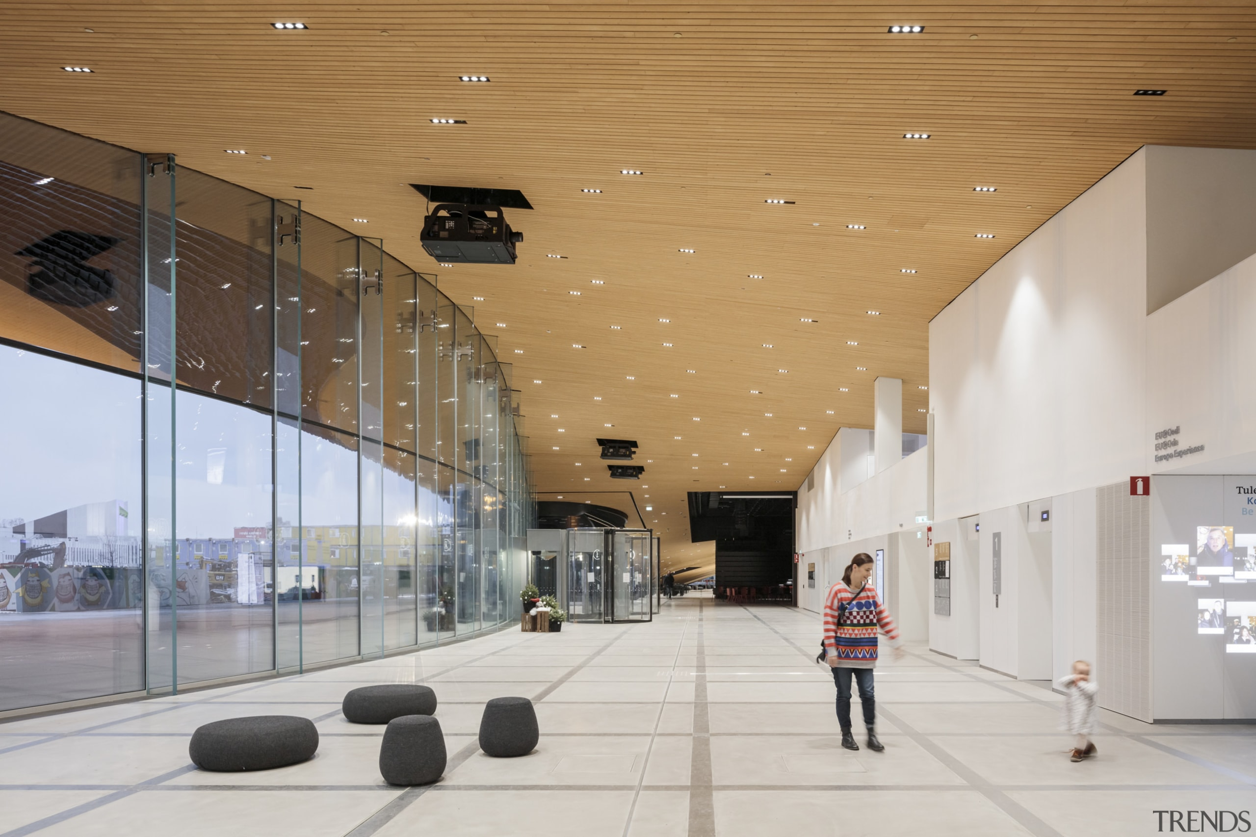 The Helsinki library by ALA Architects engages with architecture, building, ceiling, design, interior design, lobby, shopping mall, gray