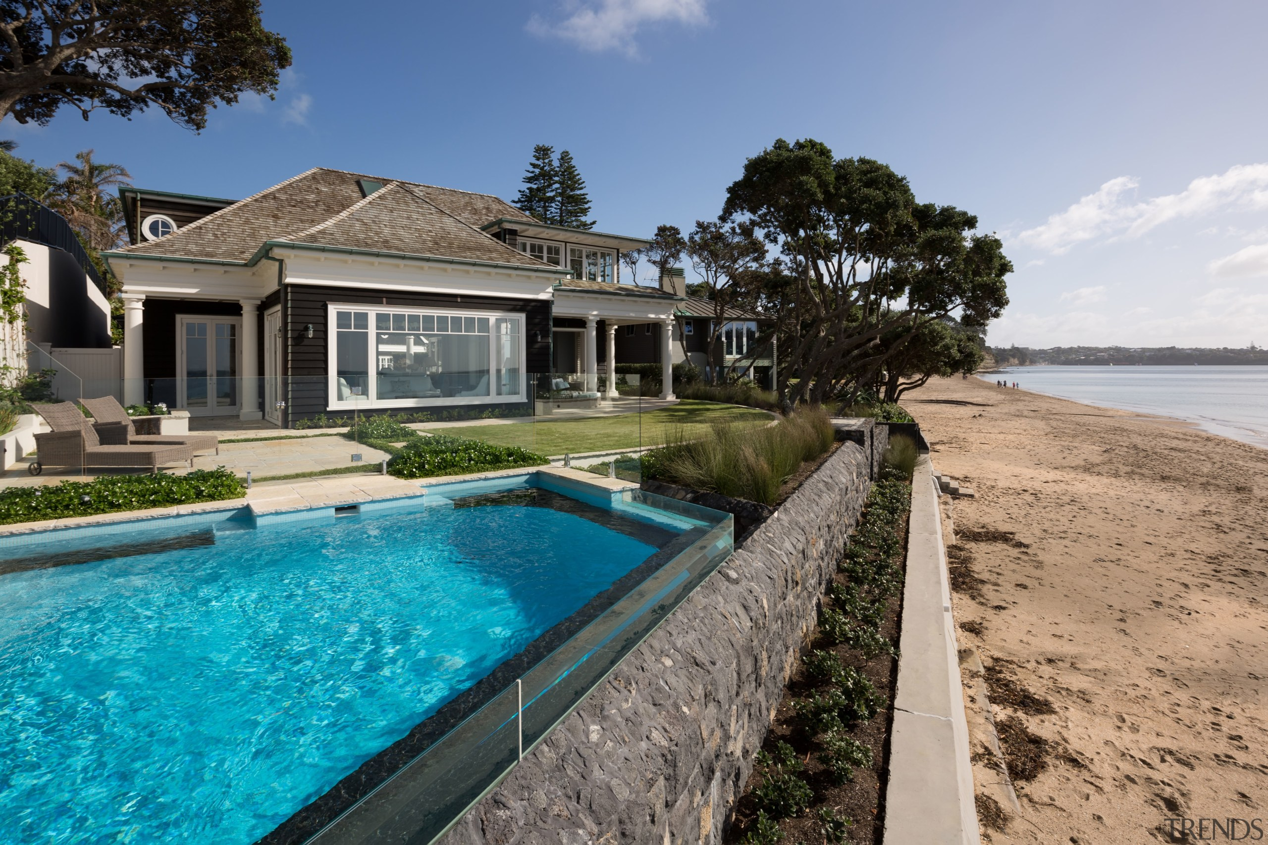 This homes seaward side has two sheltered outdoor cottage, estate, home, house, property, real estate, resort, swimming pool, villa, gray