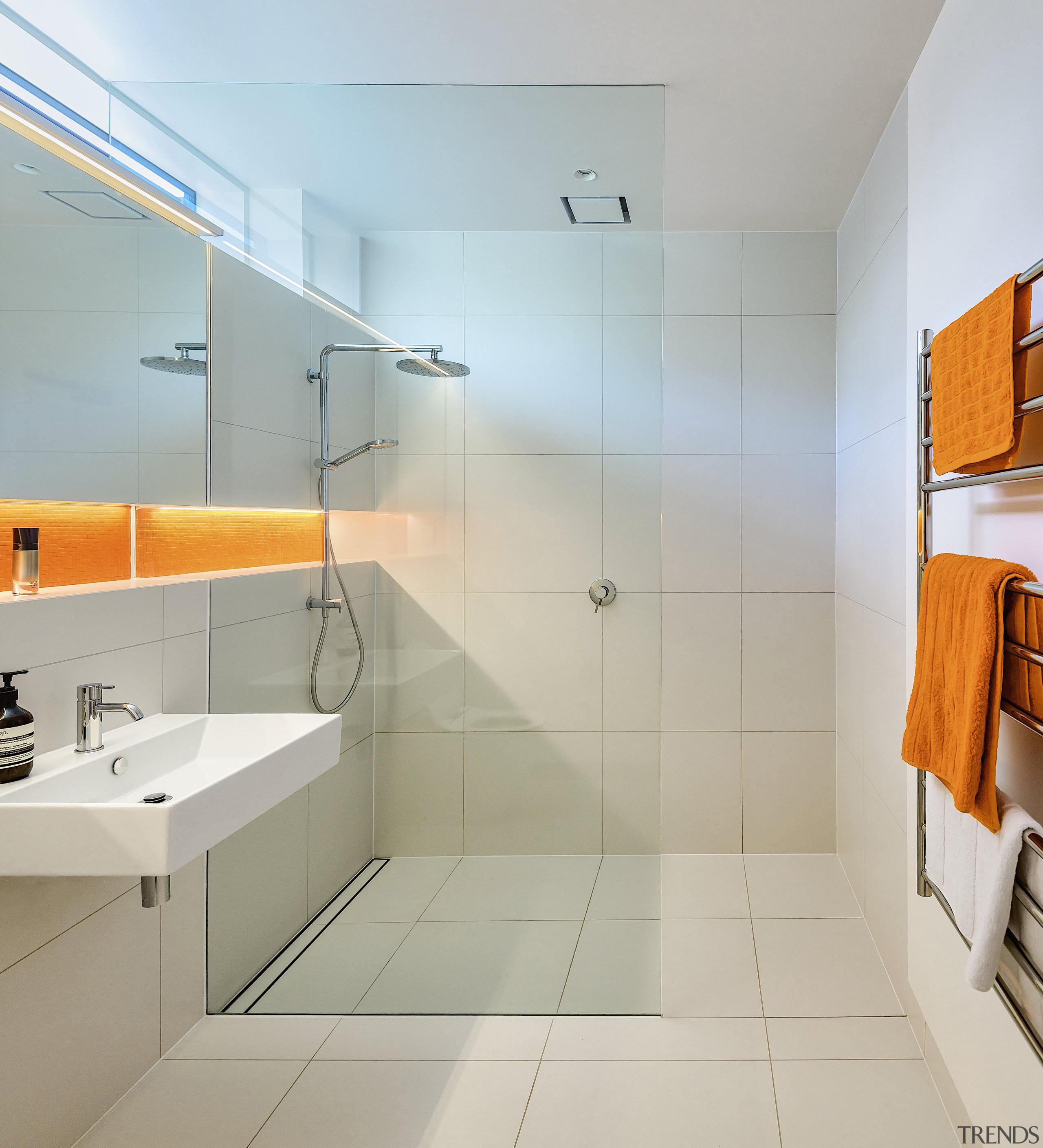A brilliant strip of orange mosaic tiles add