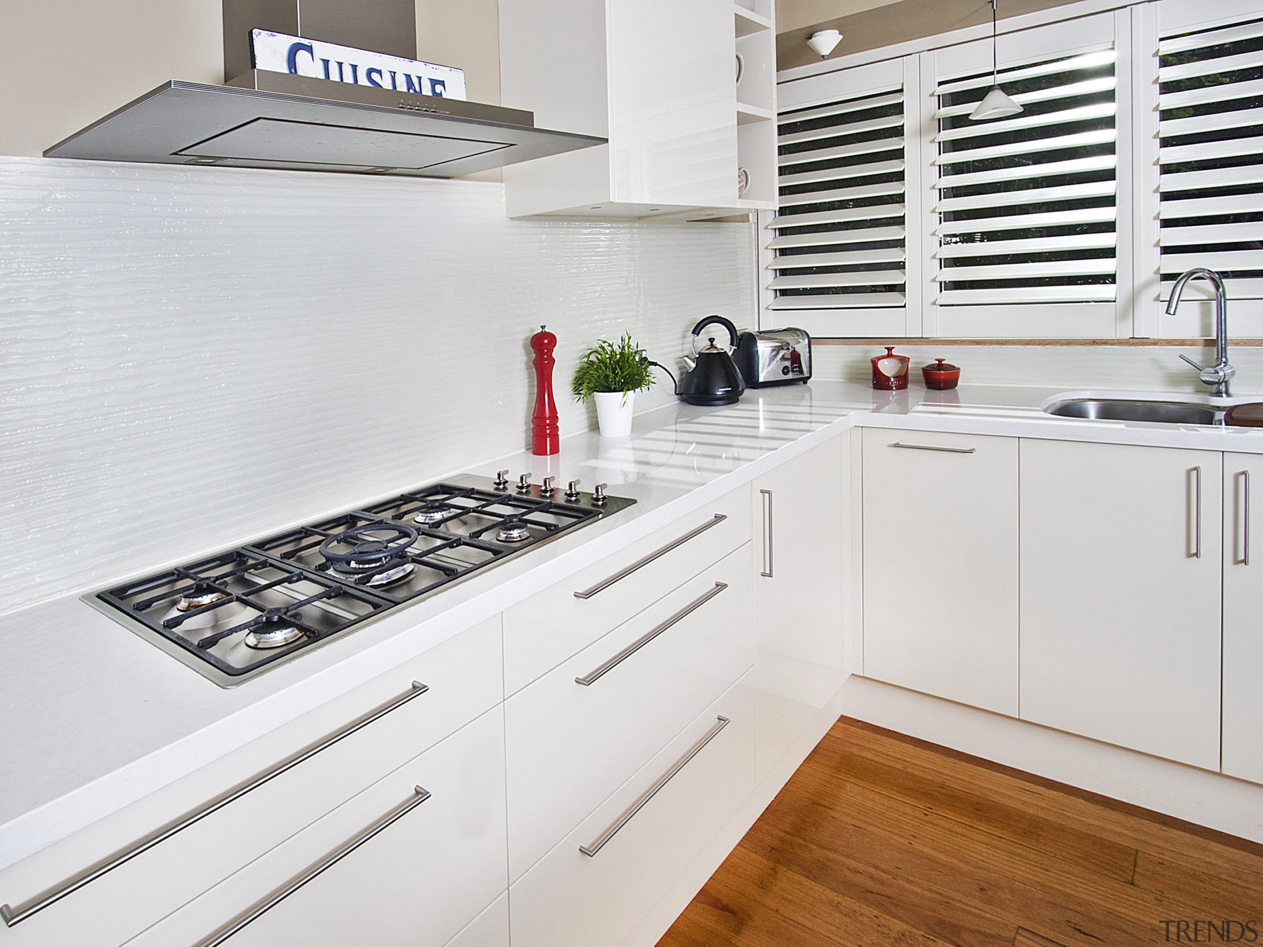 View of kitchen featuring wood floors, white bench cabinetry, countertop, cuisine classique, floor, interior design, kitchen, room, white