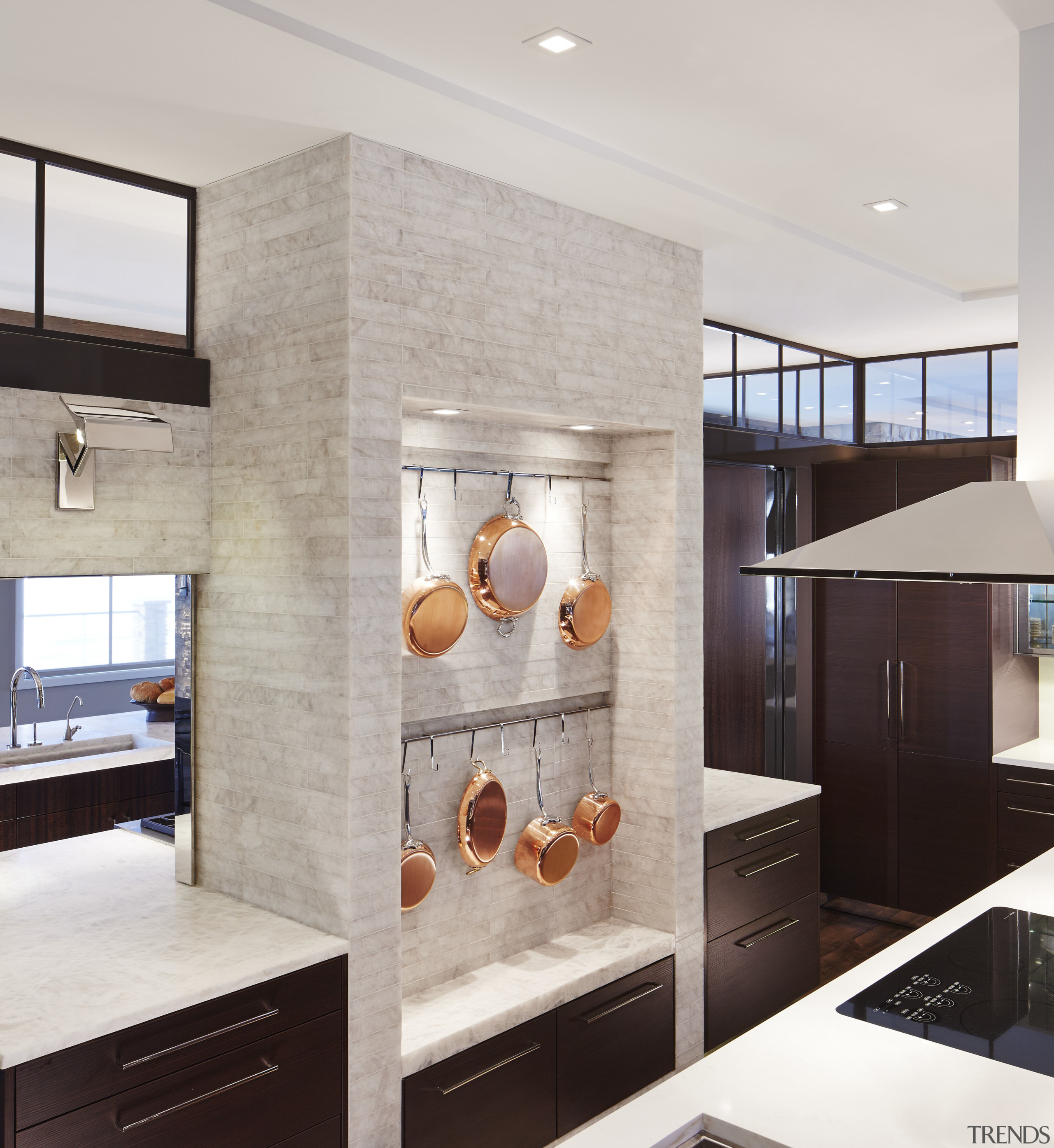 A central stone section divides the back-to-back kitchens cabinetry, countertop, cuisine classique, floor, flooring, home appliance, interior design, kitchen, gray