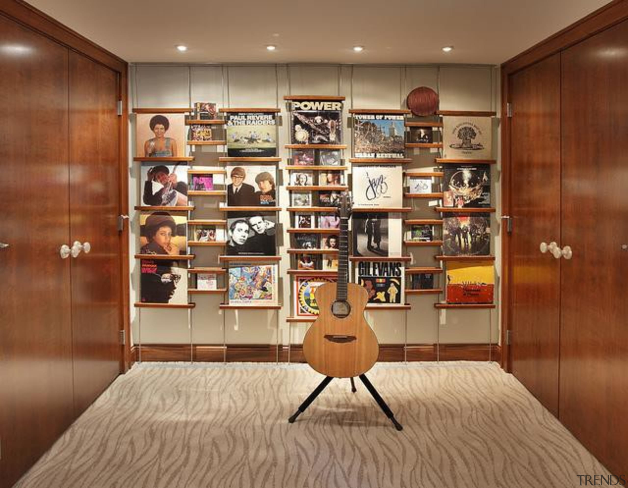 Because of its expansive and wide-open layout, a bookcase, cabinetry, closet, floor, flooring, furniture, interior design, room, shelf, shelving, brown